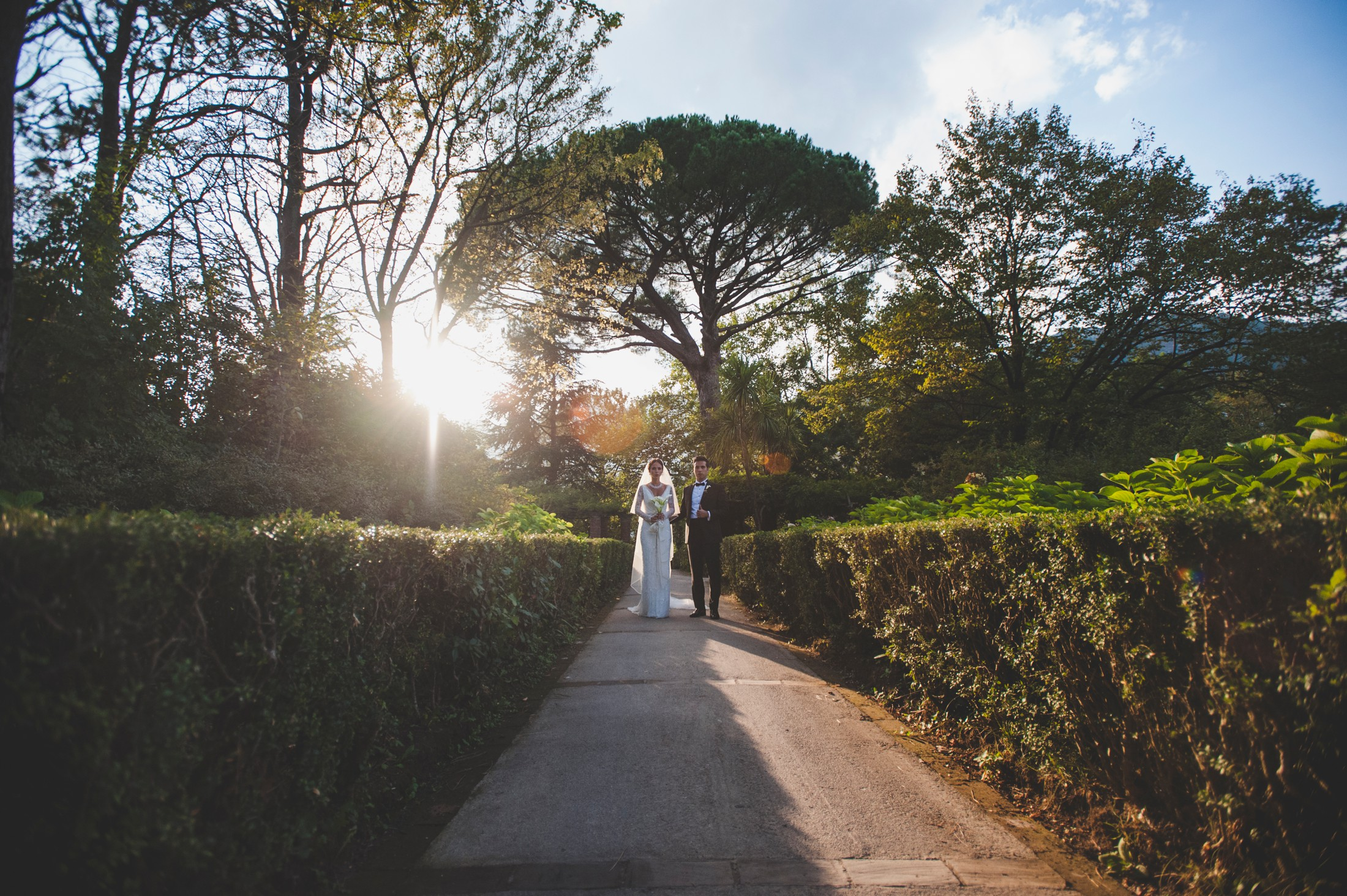 luxury wedding the bride walking with her brother at villa cimbrone in ravello