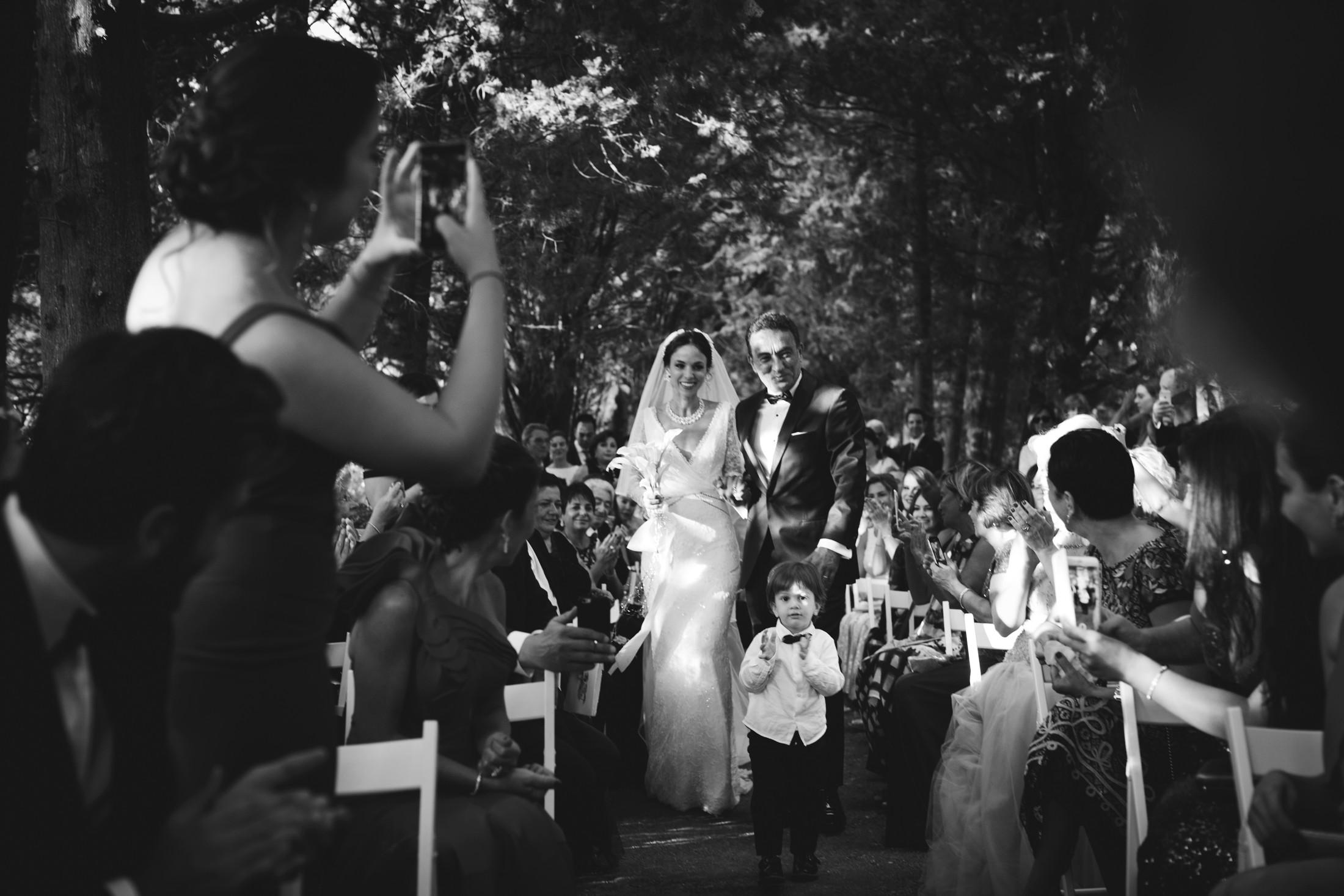luxury wedding the bride walking down the aisle in villa cimbrone ravello