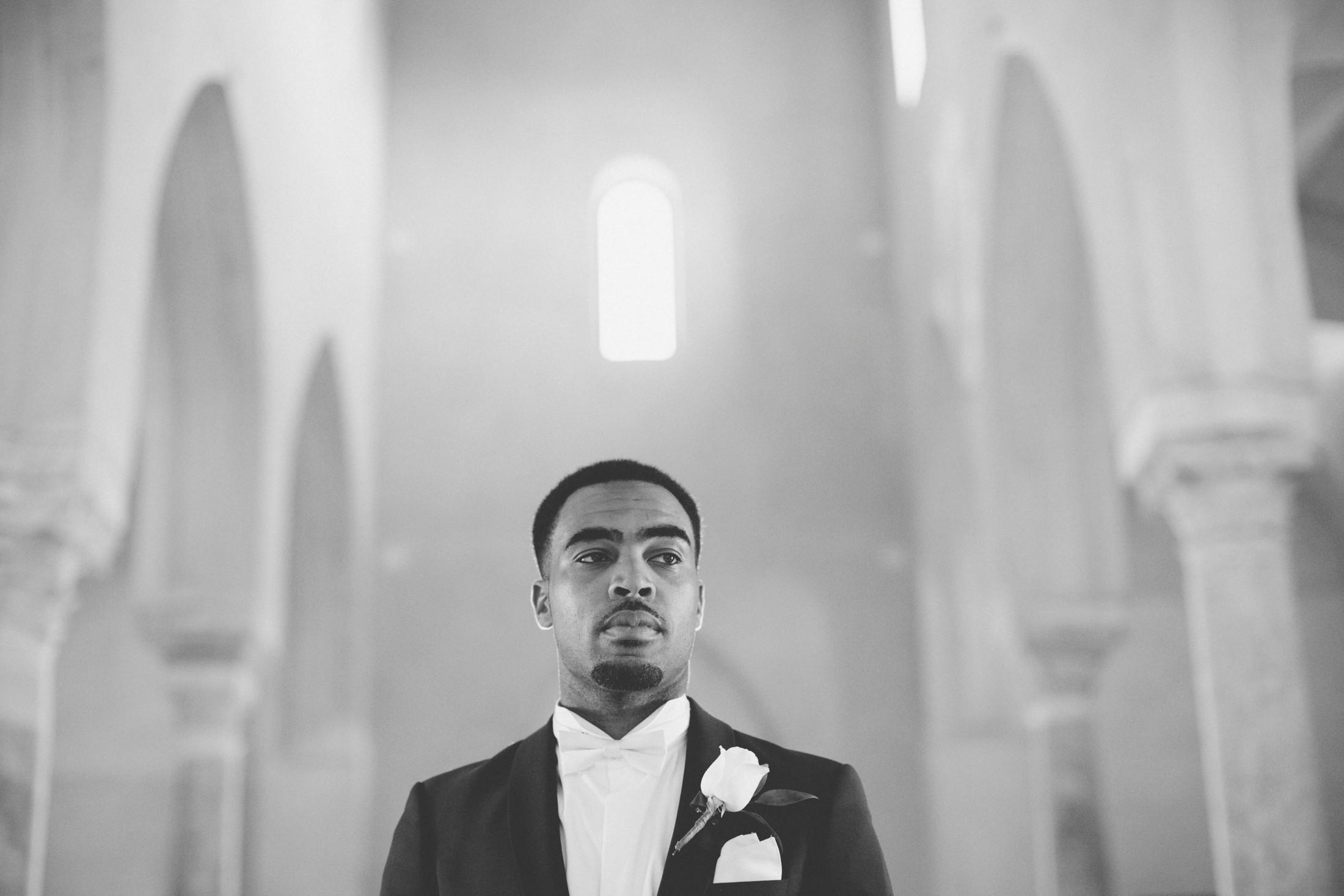 wedding in italy groom's portrait inside the church