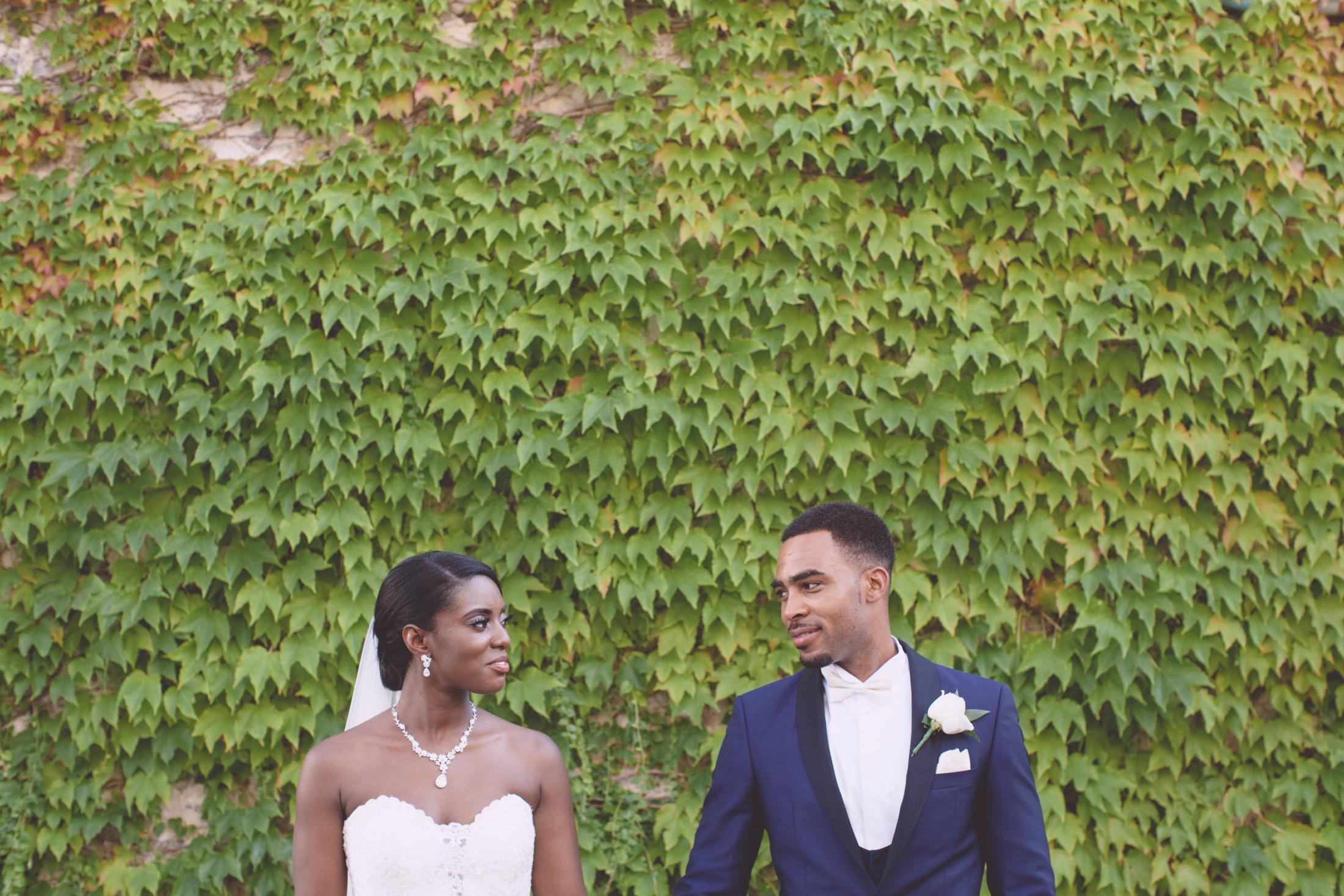 wedding in italy bride and groom's portrait against an ivy wall in ravello