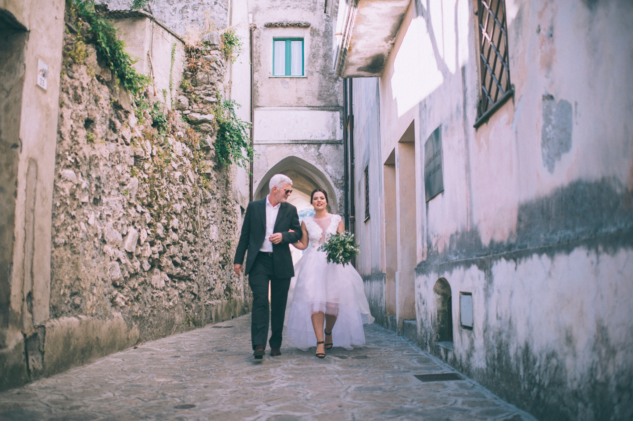 rustic wedding in ravello the bride walking with her father