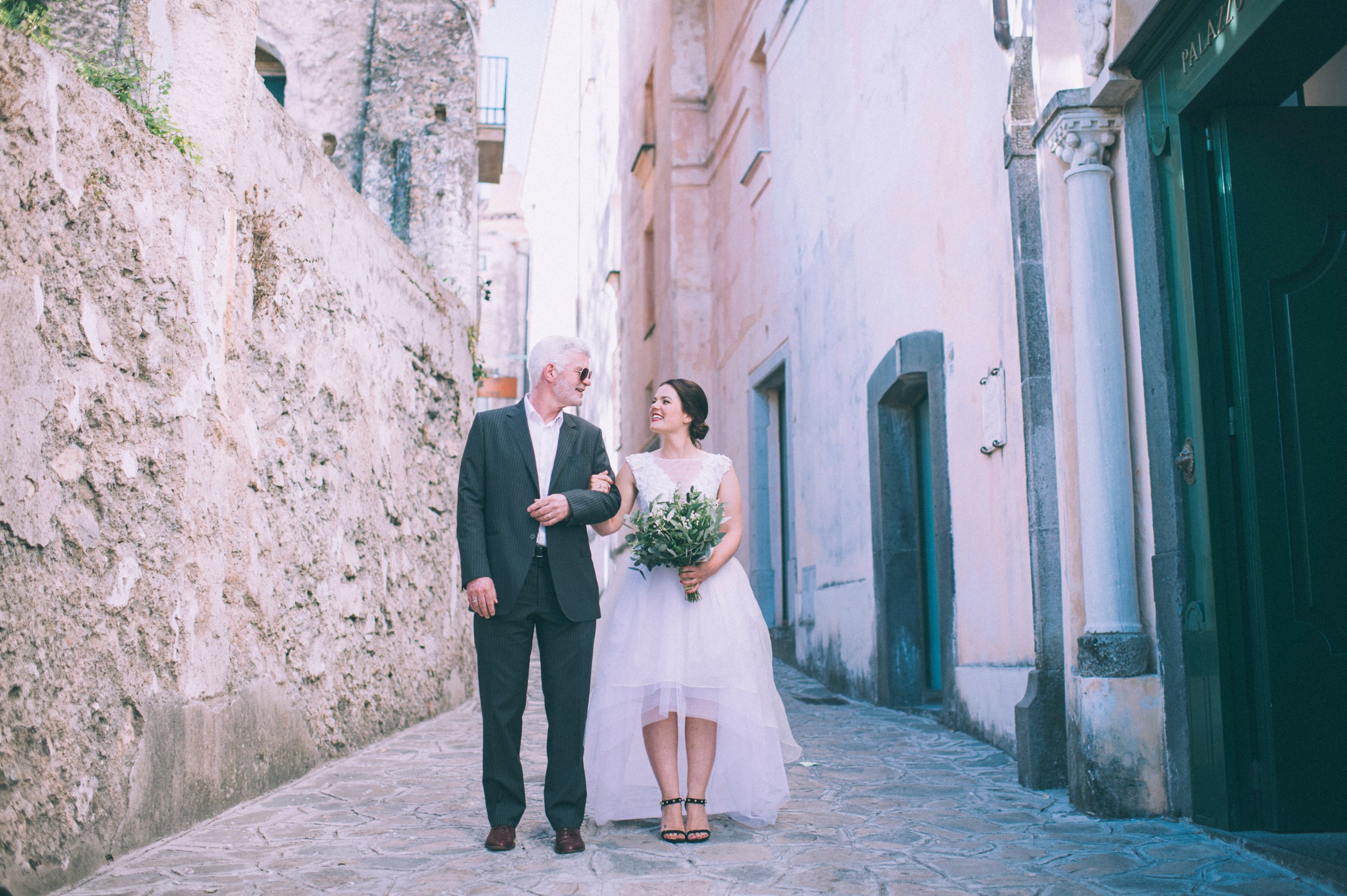 rustic wedding in ravello the bride standing next to her father
