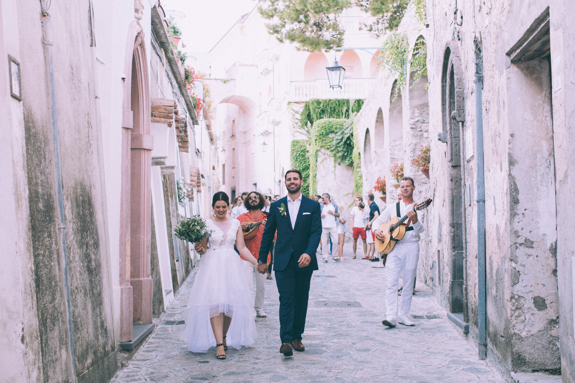 rustic wedding in ravello the bride and the groom walking together in ravello