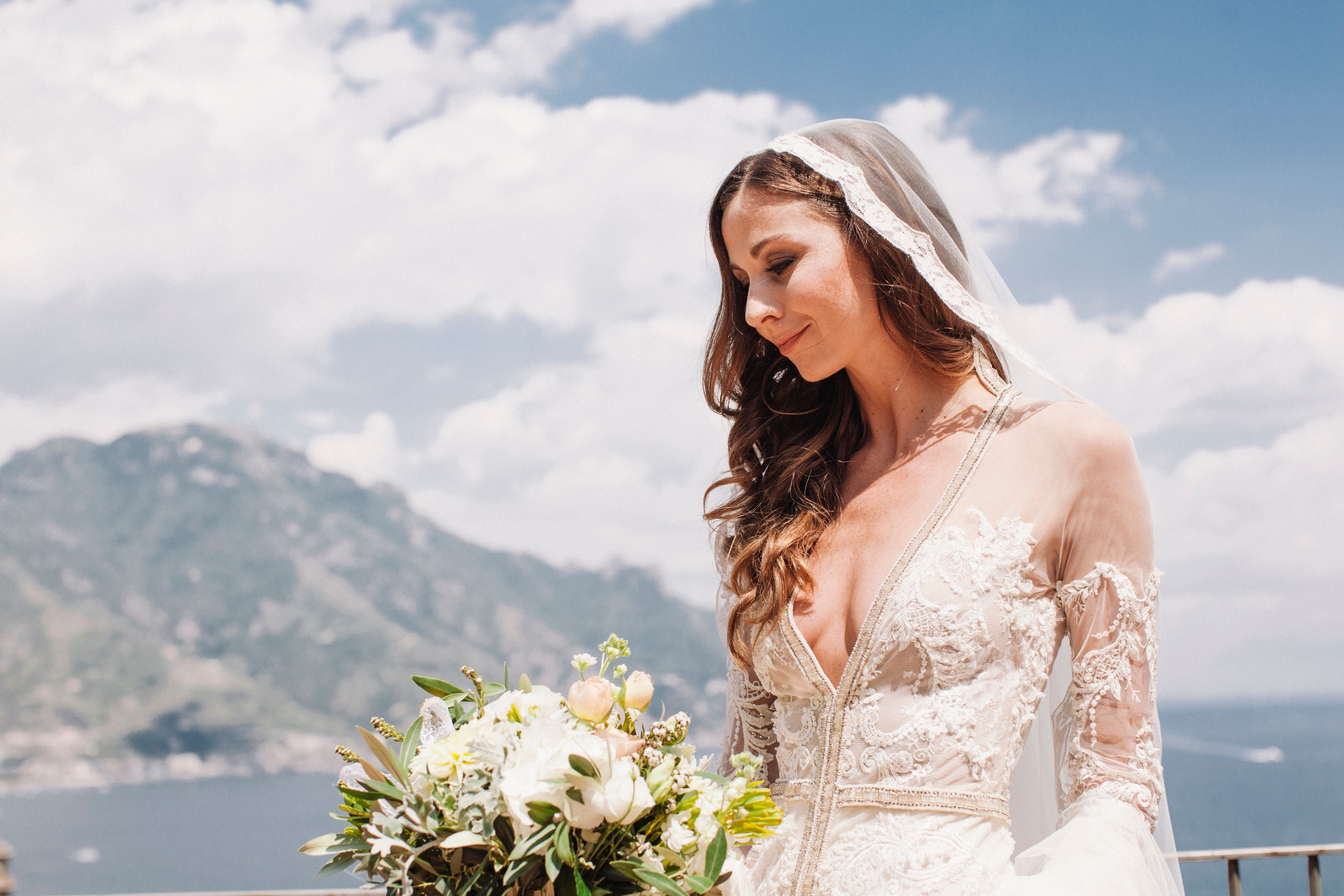 wedding at villa cimbrone - bride's portrait on the balcony with mountains as background