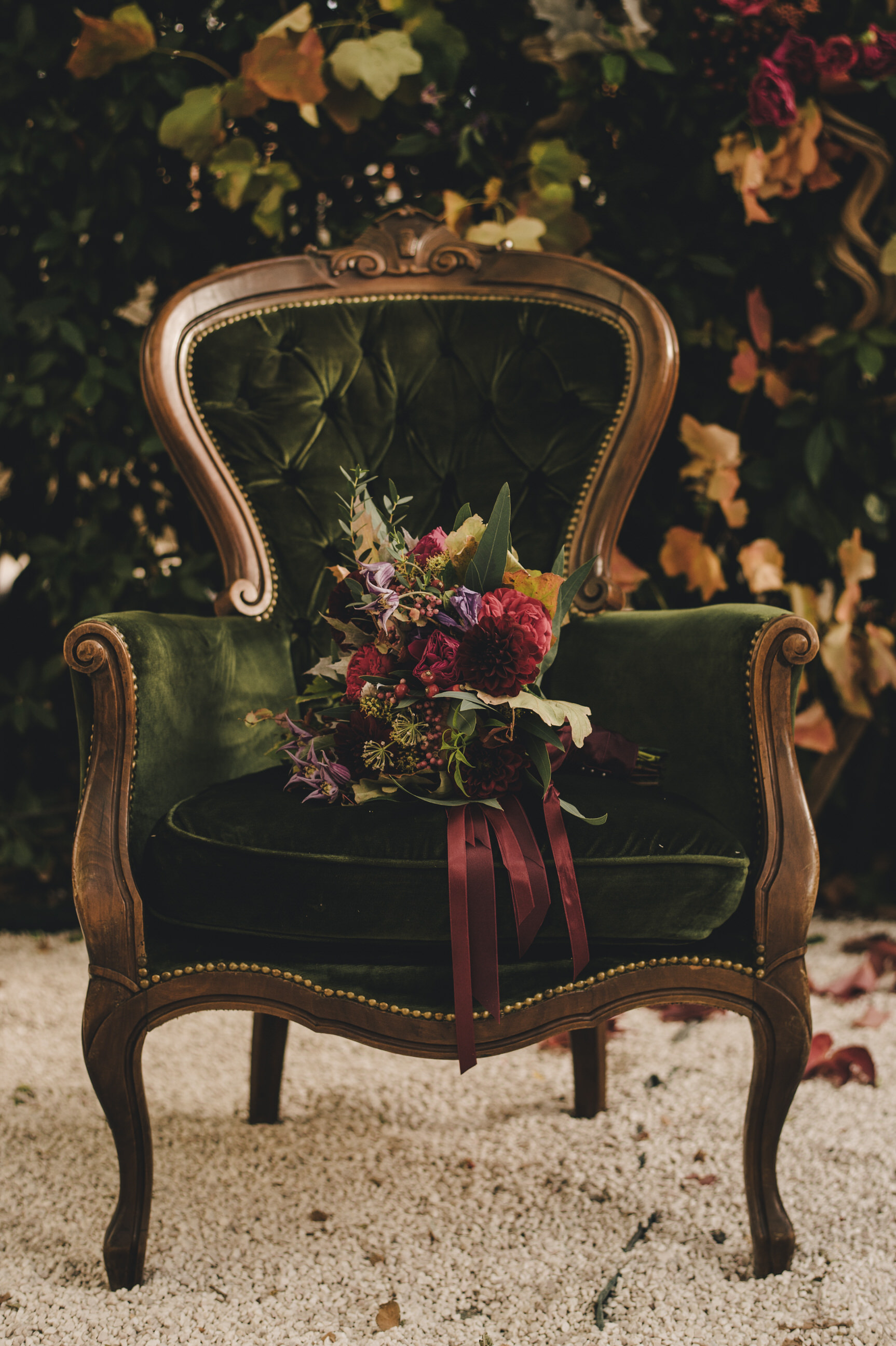 moody wedding bouquet on a green velvet chair