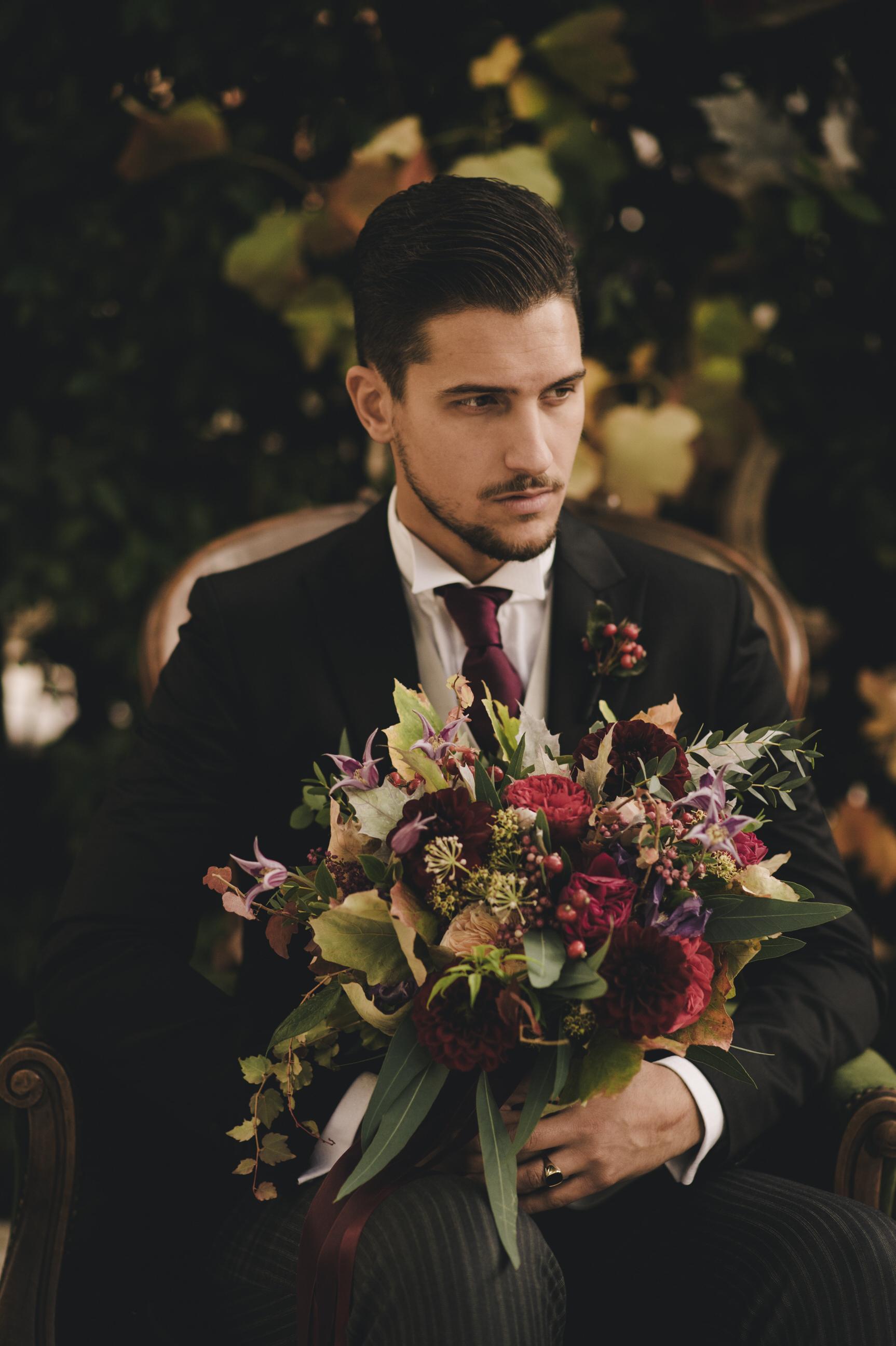 groom's portrait holding the bouquet