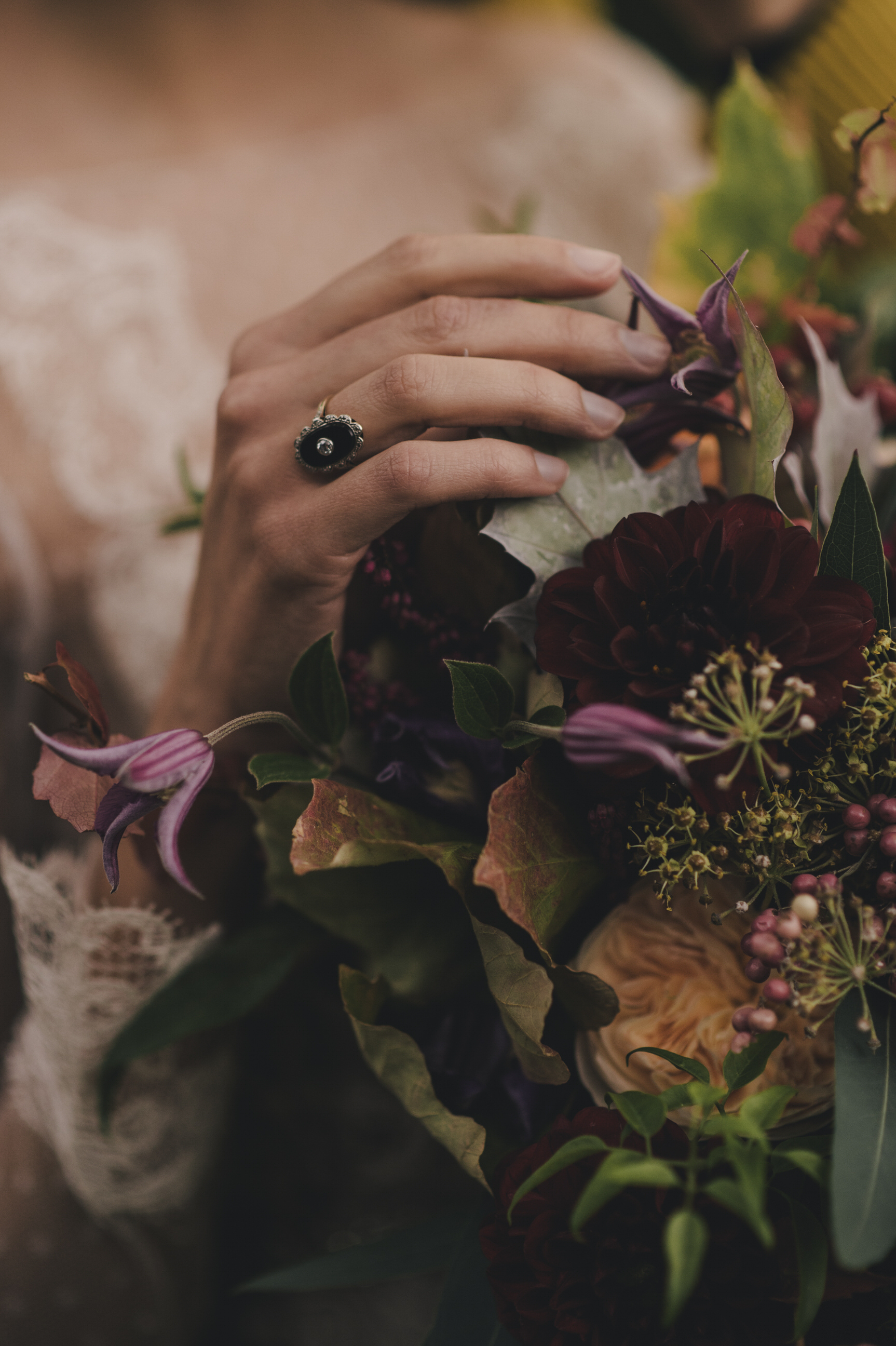 hands touching the bouquet