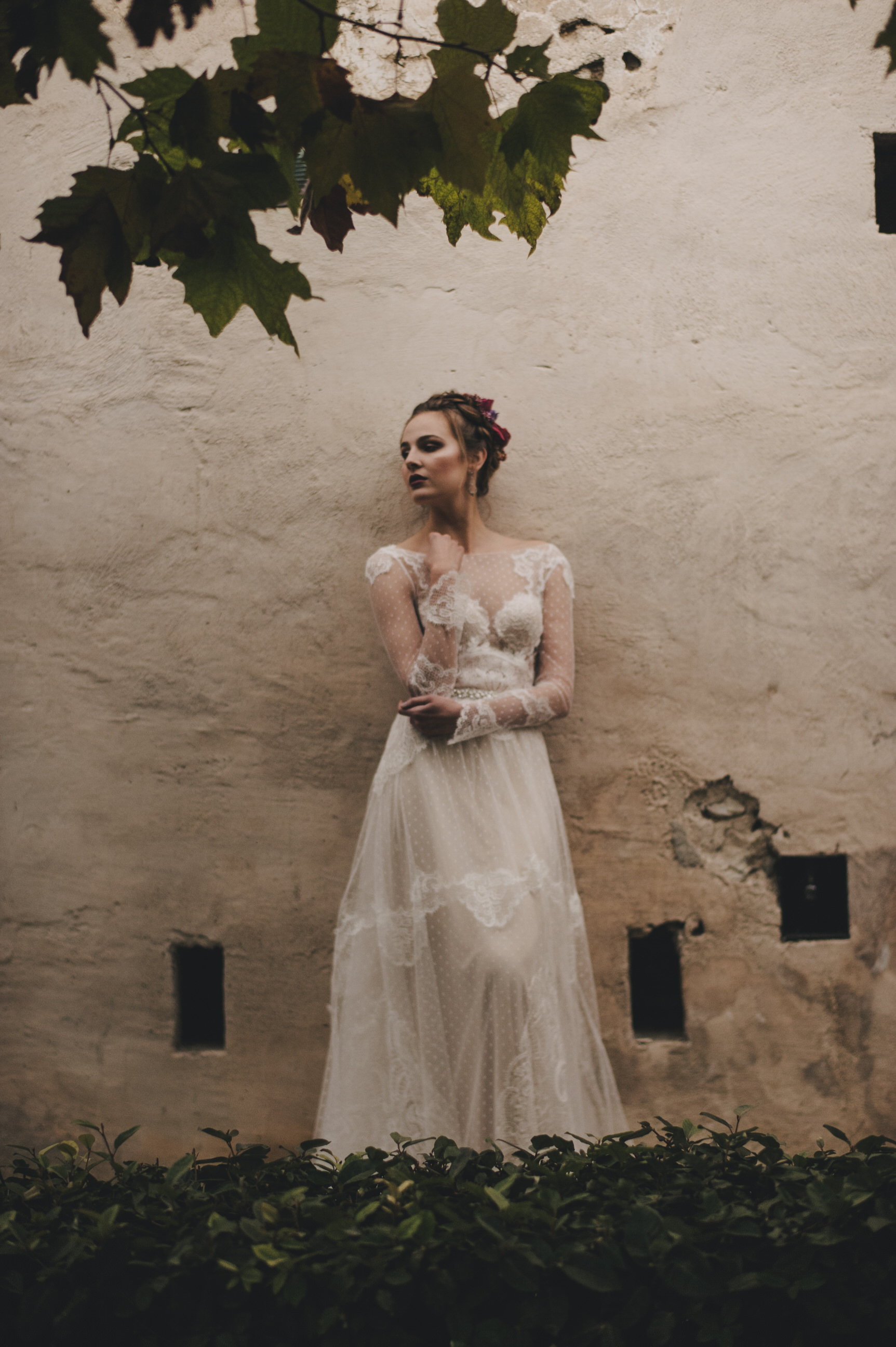 bride lining against a white wall