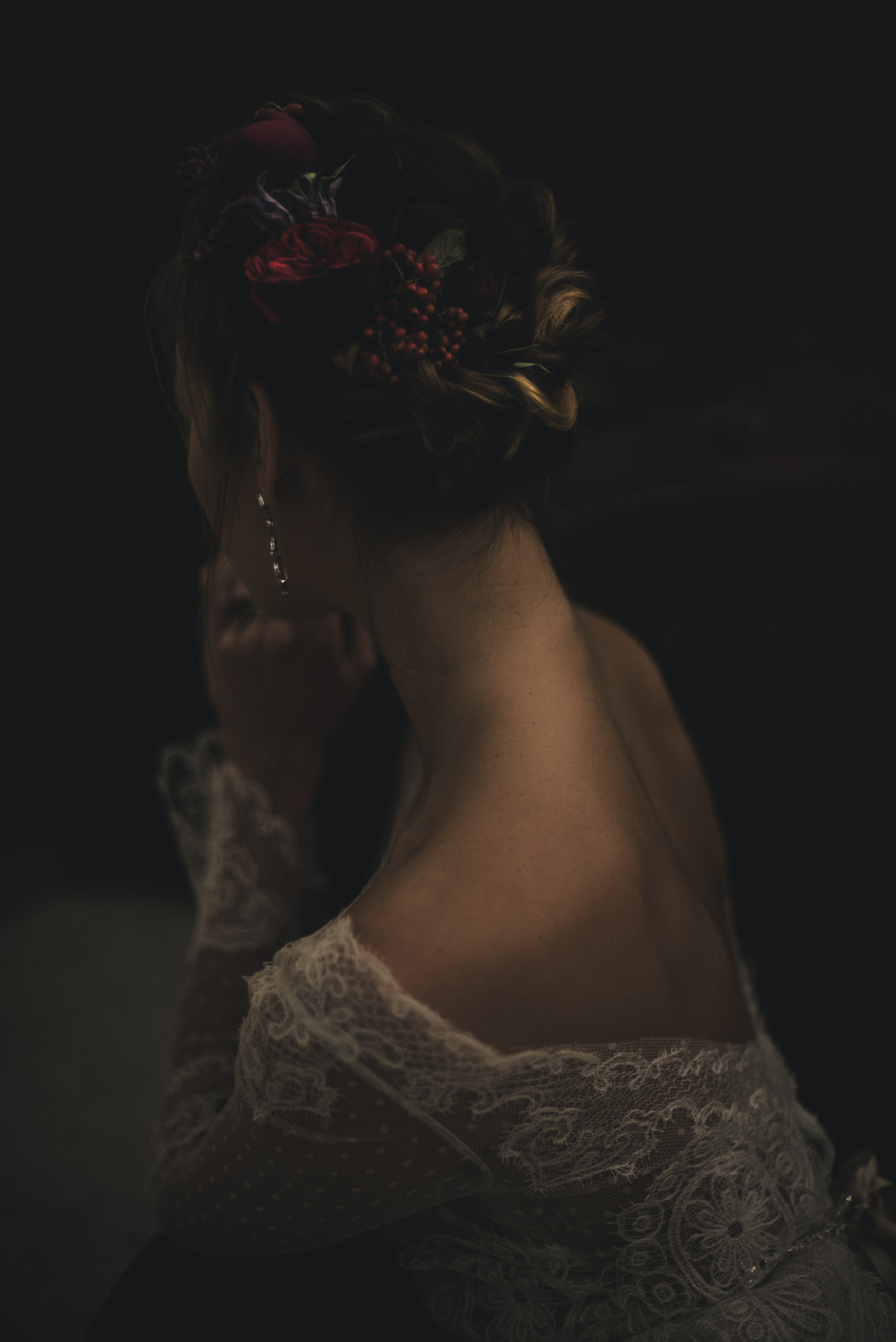 bride's hairstyle with red flowers