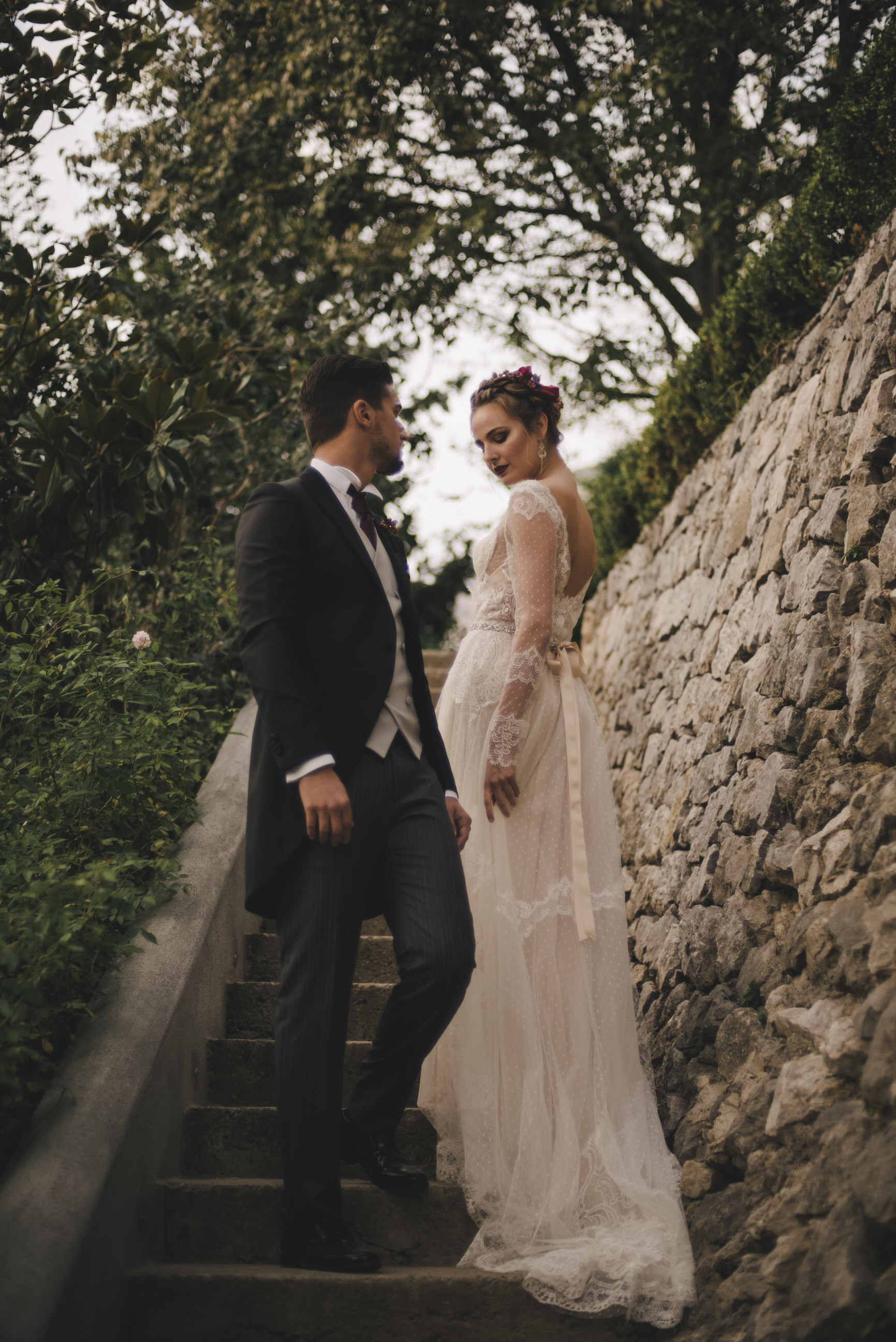 bride and groom's portrait on the stairs