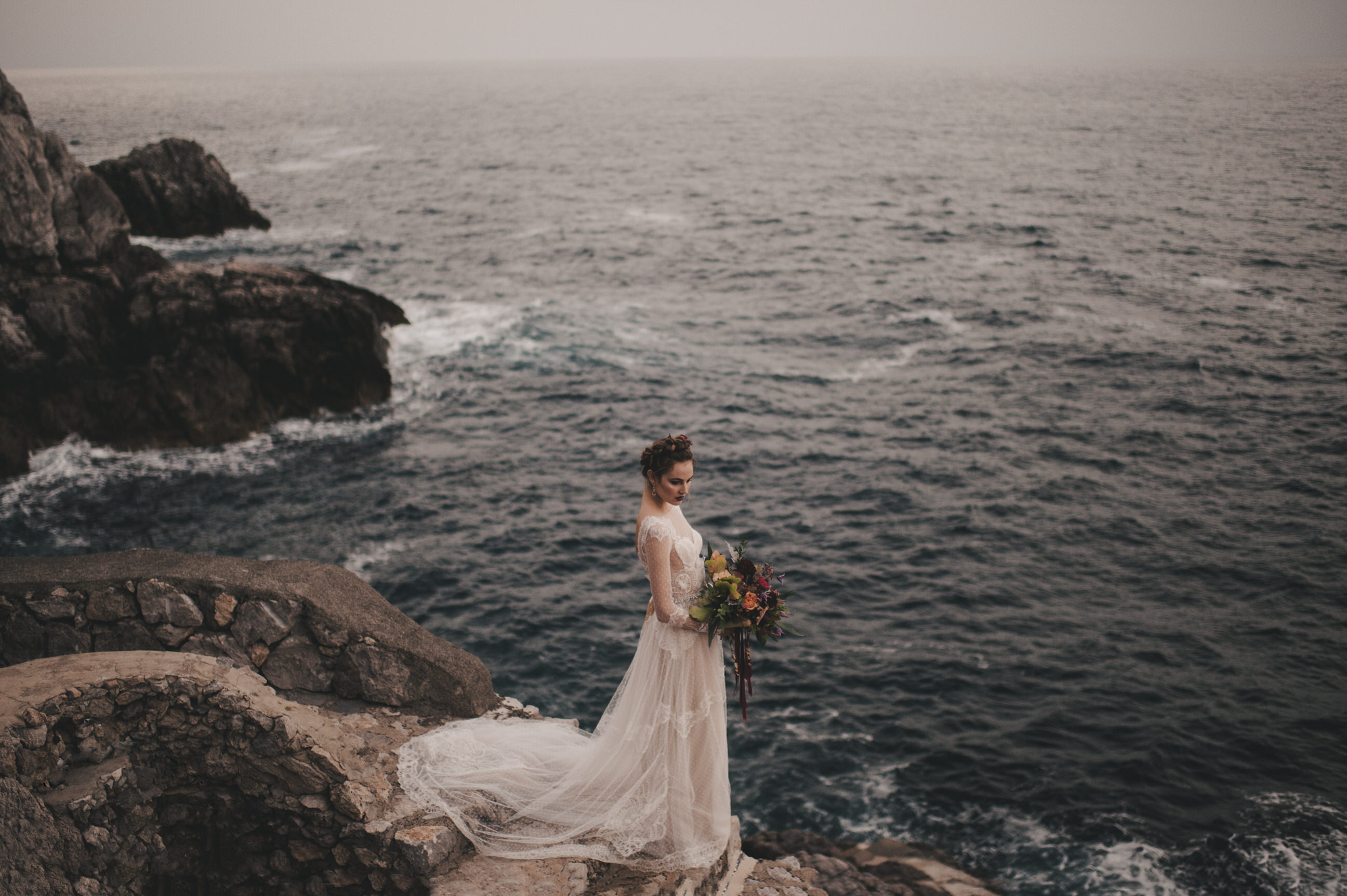 bride's portrait standing by the sea