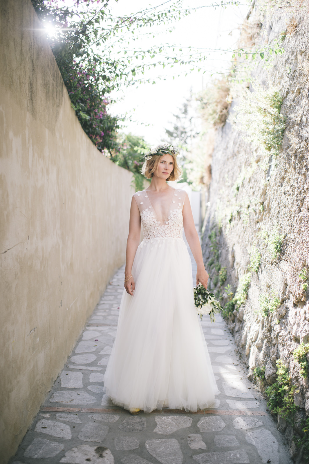 bride's portrait standing in a narrow street of praiano amalfi coast