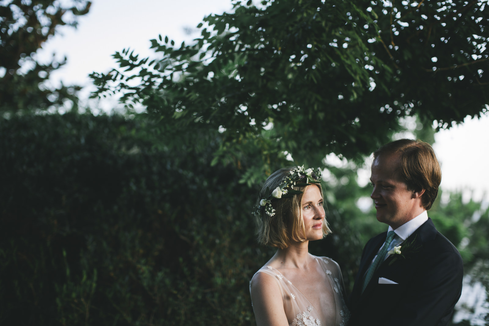 bride and groom's portrait in a garden