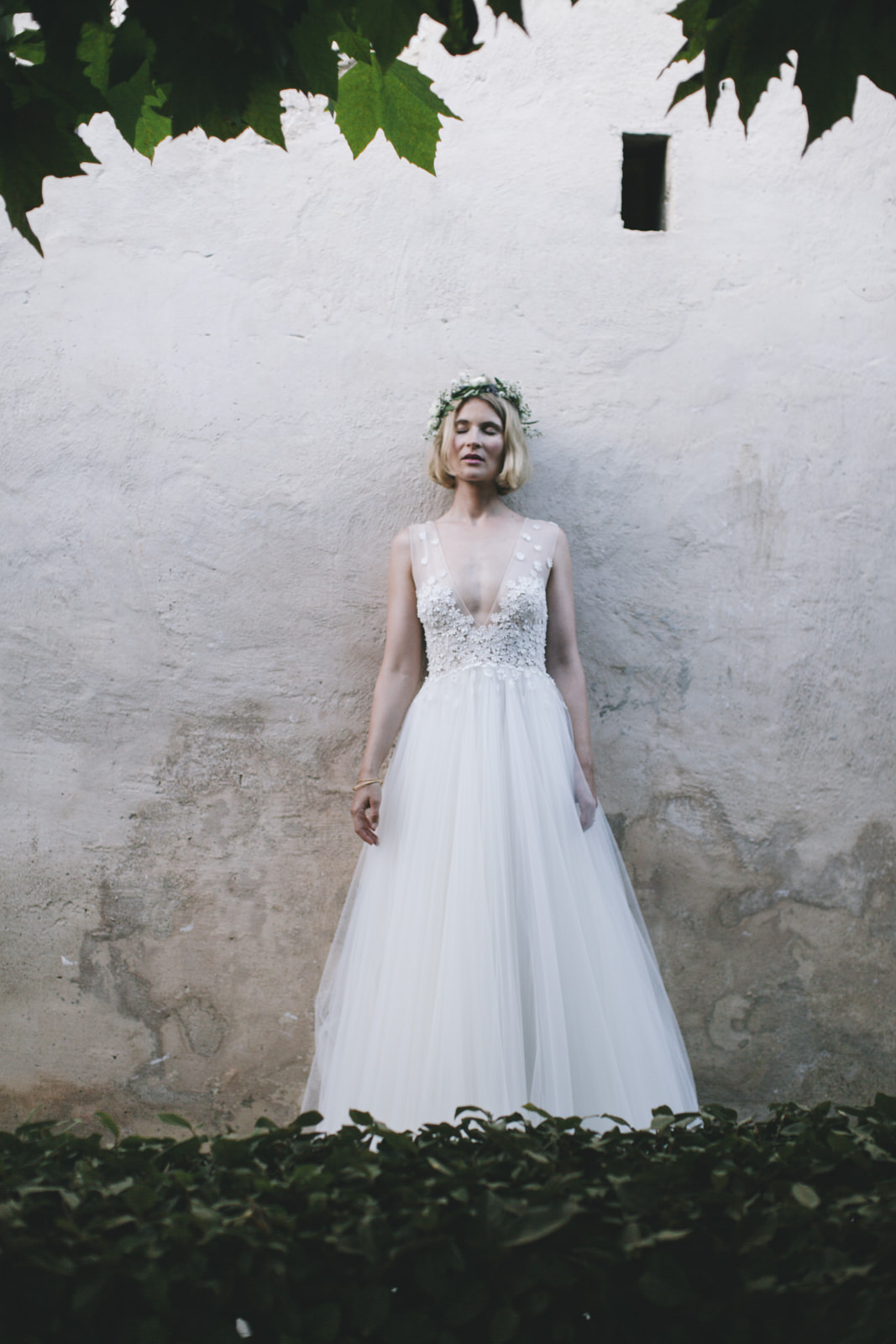 the bride lining against a white wall