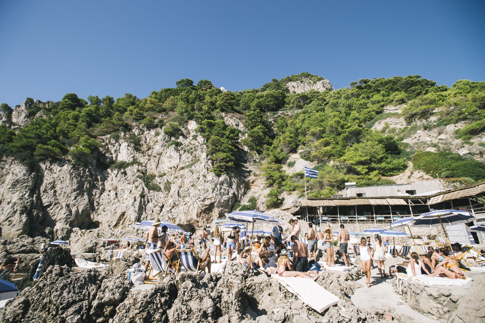 people during a party on the cliffs of la fontelina in capri