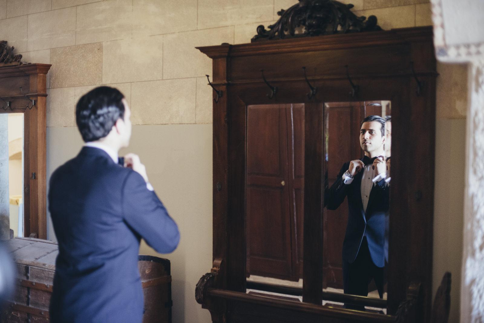 groom adjusting is bow tie