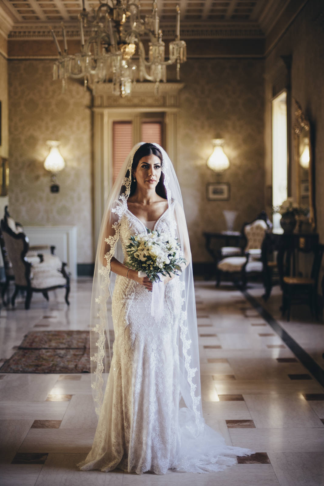 the bride standing with her bouquet
