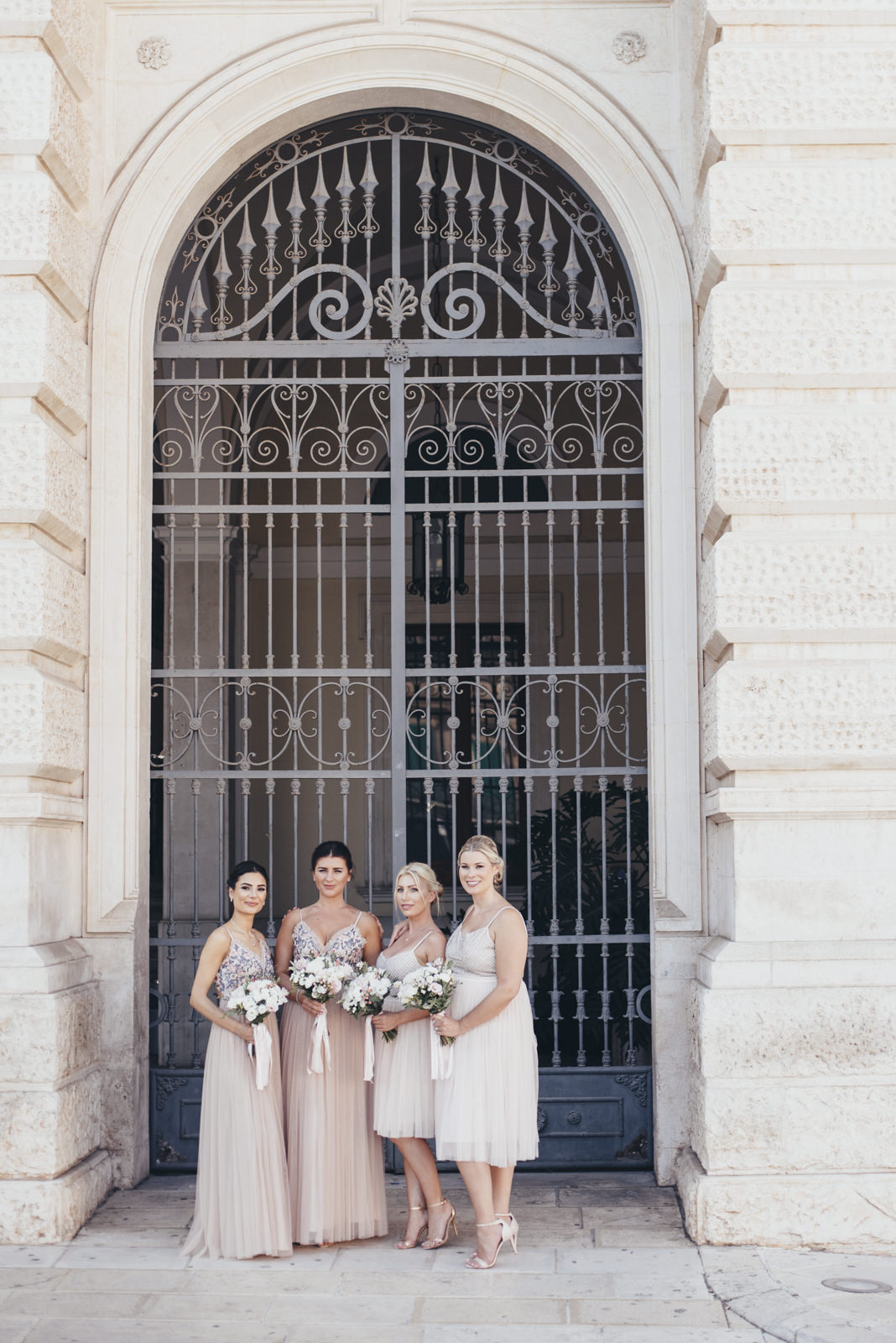 bridesmaids standing with their bouquet and waiting for the bride