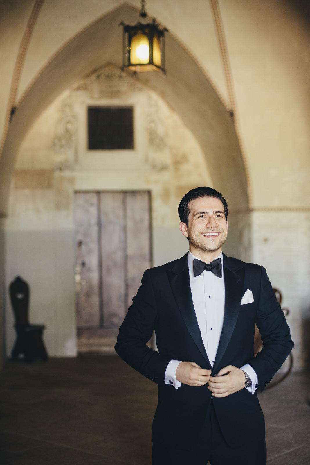 the groom wearing his jacket
