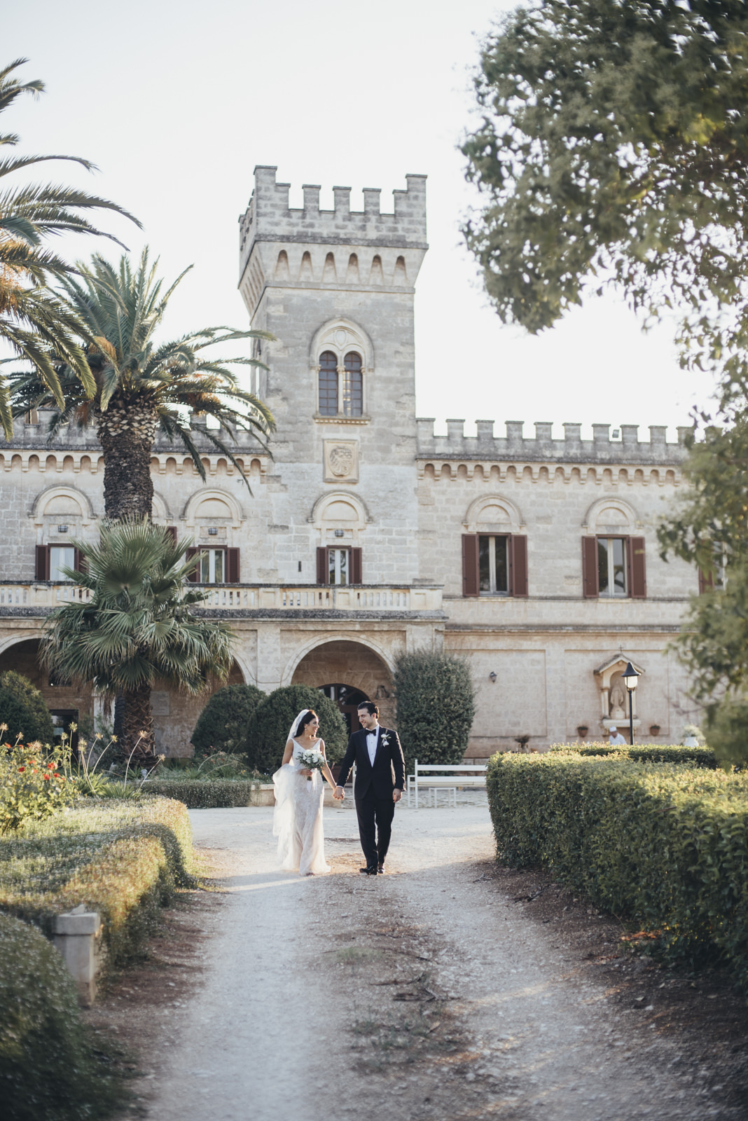 the bride and the groom walking together at masseria salamina