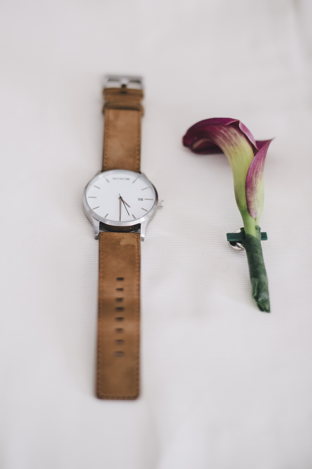 groom's watch and boutonniere