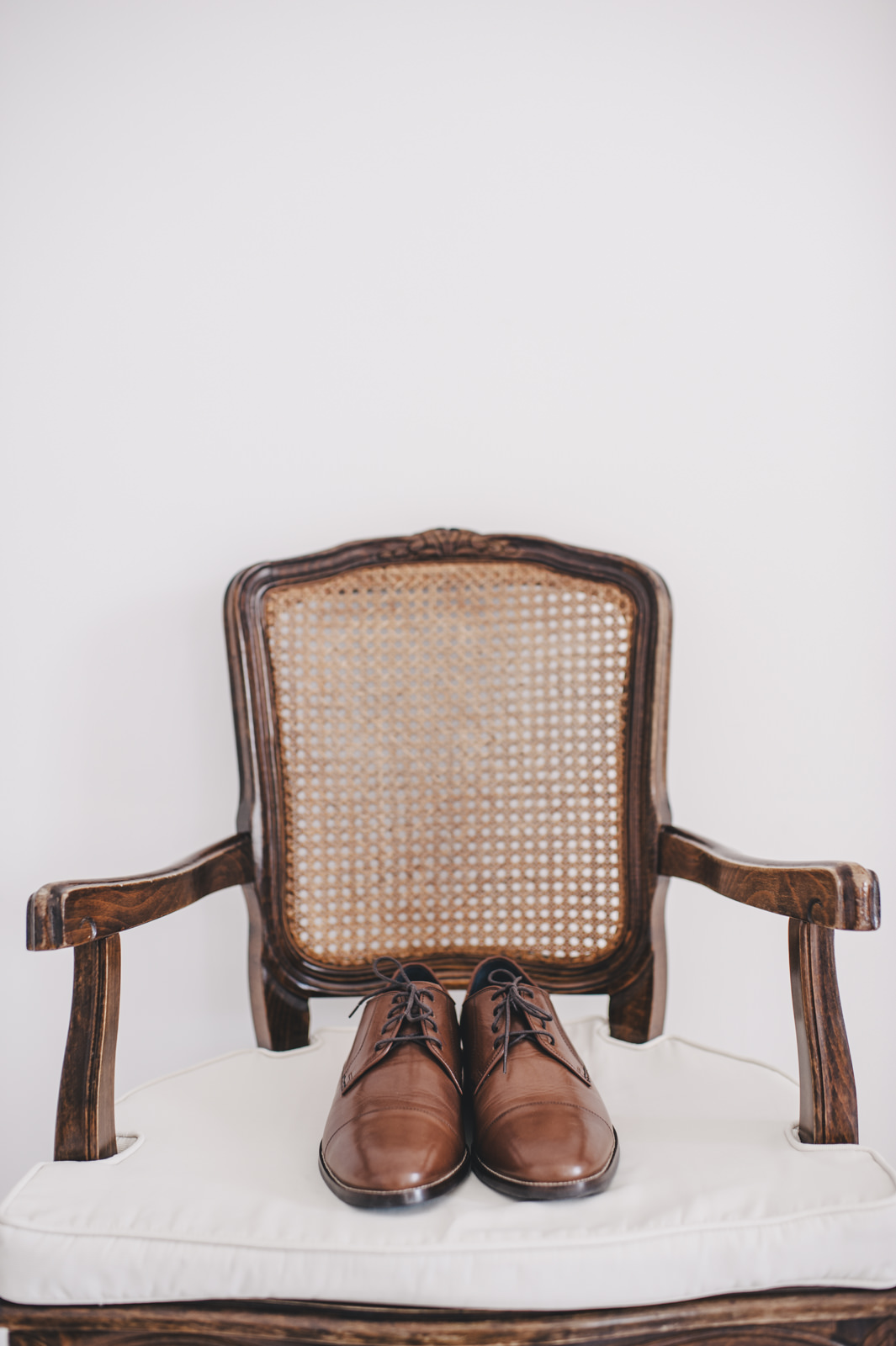 groom's shoes on a chair