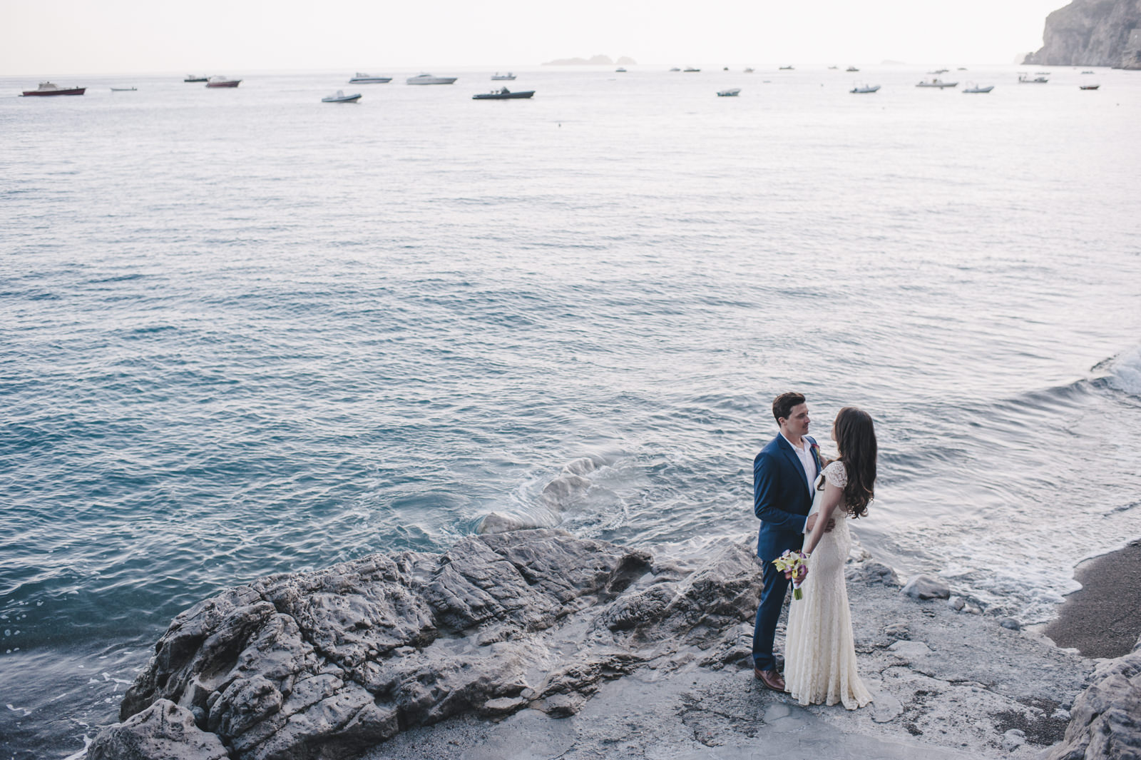 bride and groom's portrait by the sea