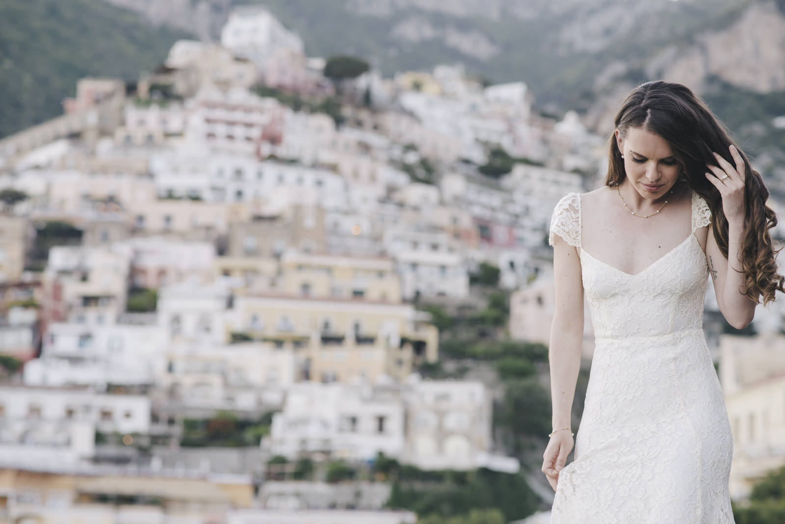 bride's portrait with positano on the background