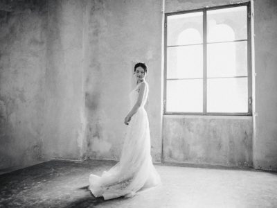 black and white portrait of the bride by a big window