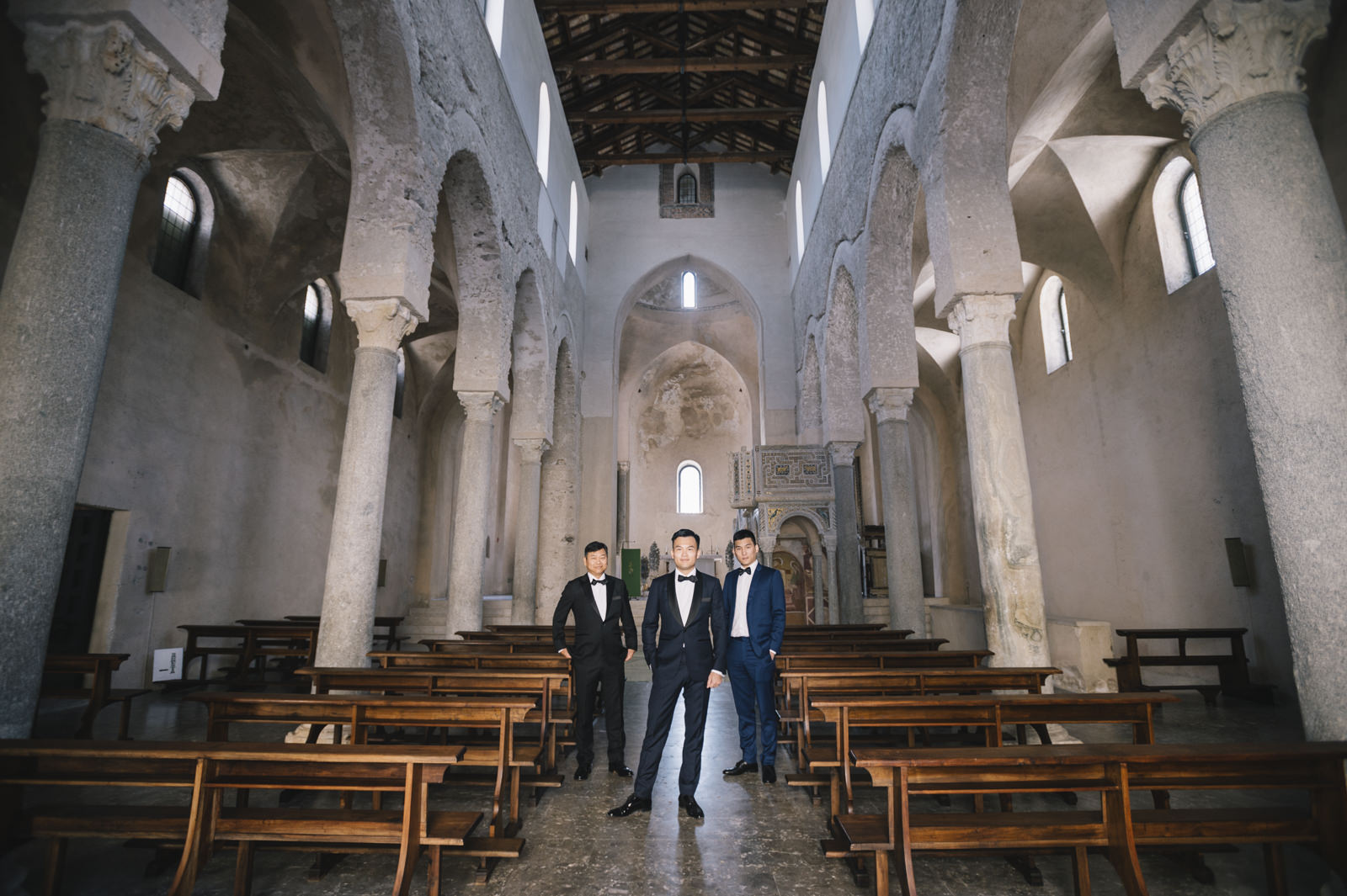 the groom with his best men inside the church