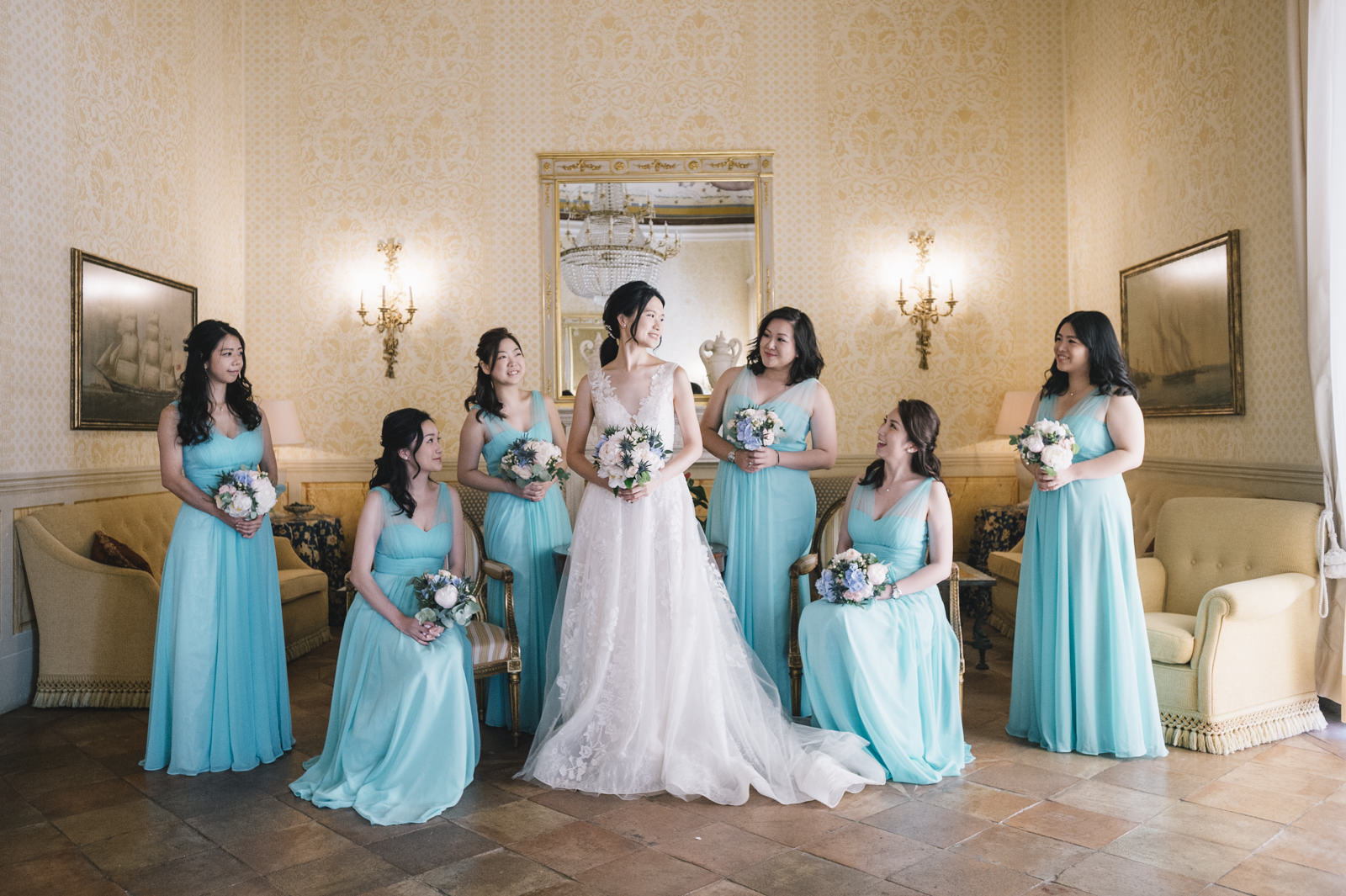 the bride with her bridesmaids in light blue dresses