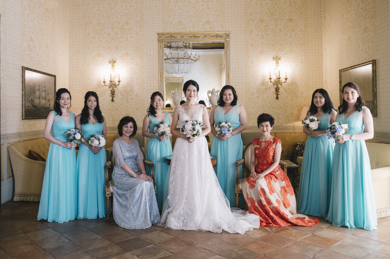 the bride surrounded by bridesmaids