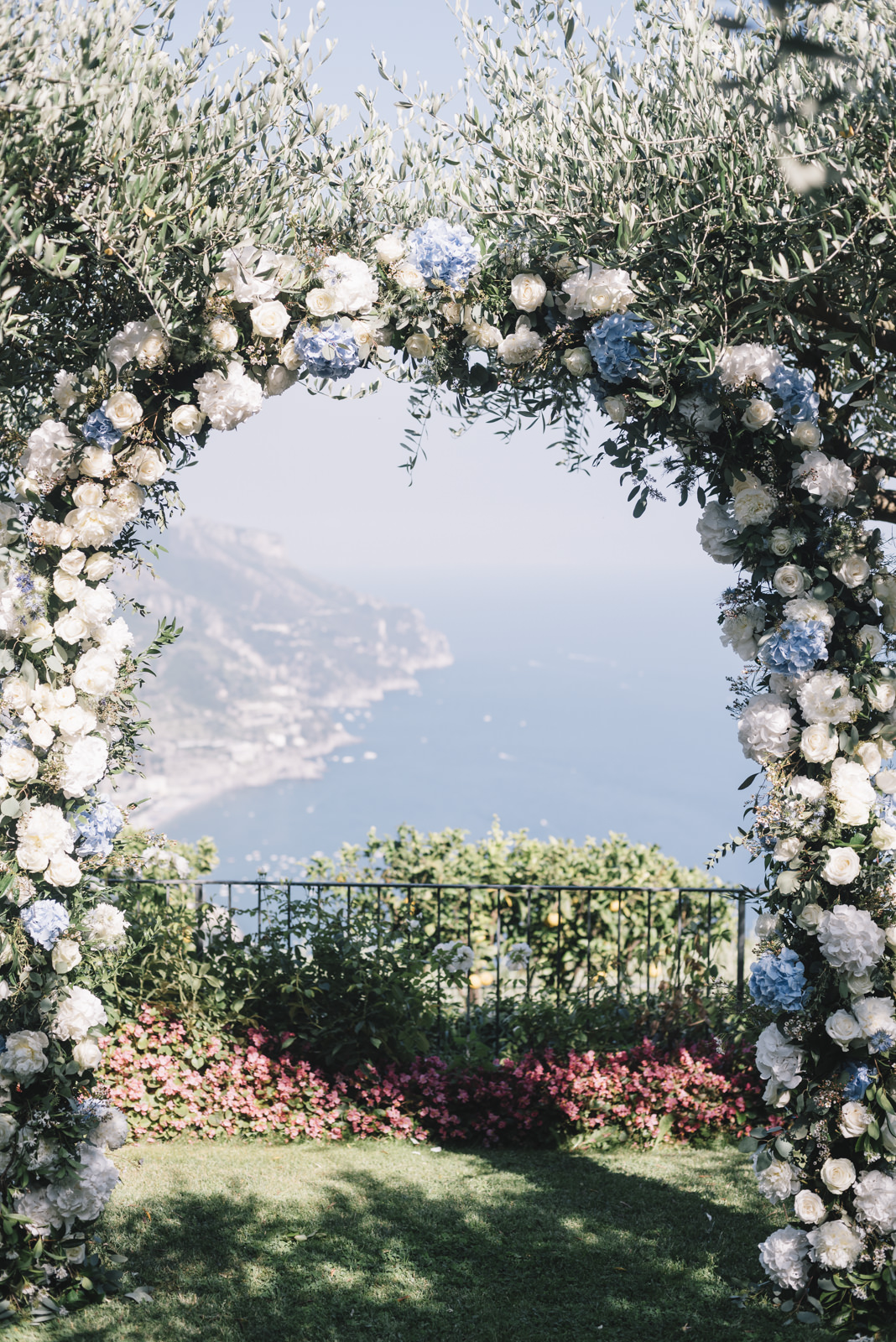 ceremony arch with white and blue flowers
