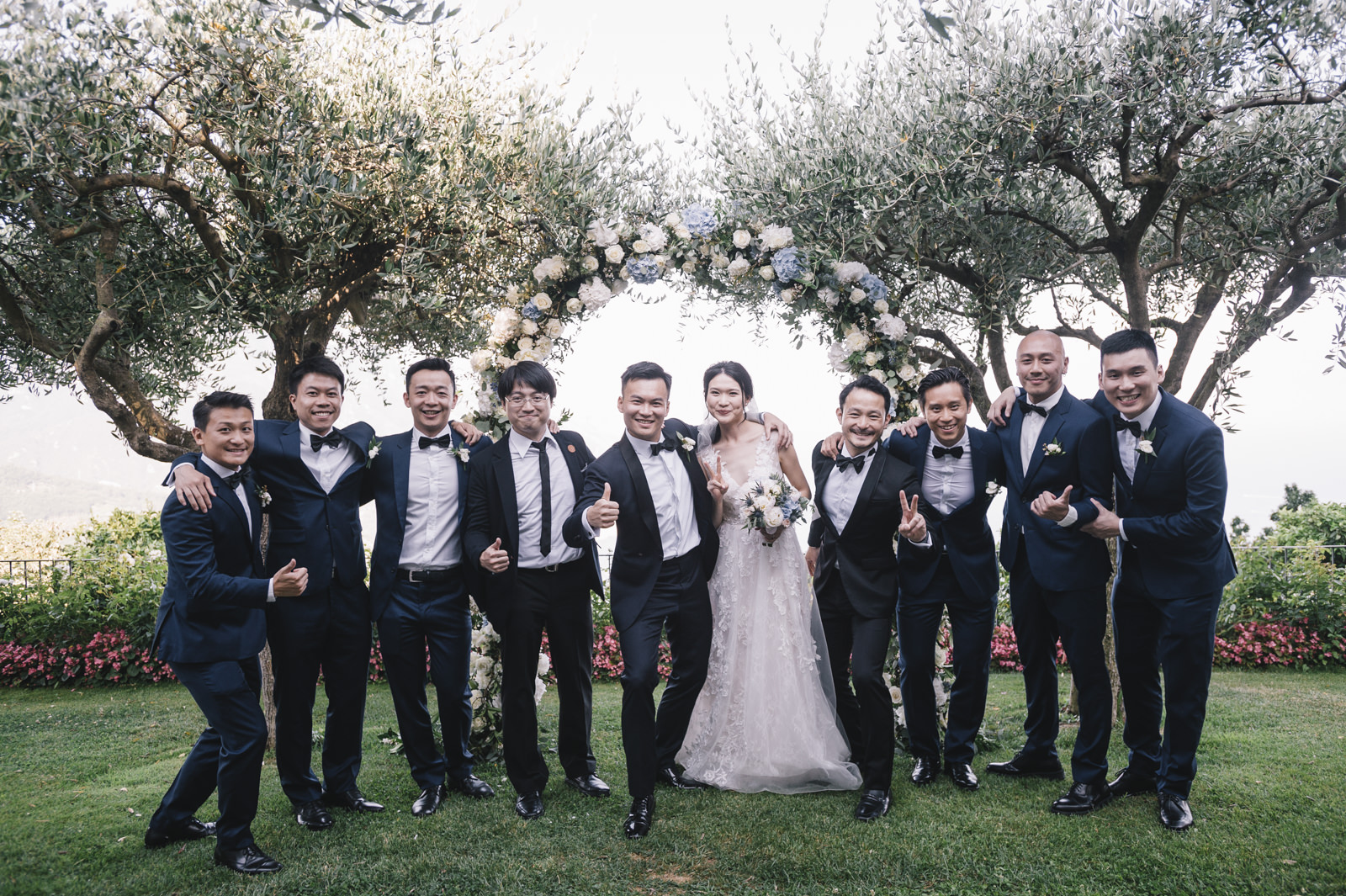 the bride and the groom with the best men