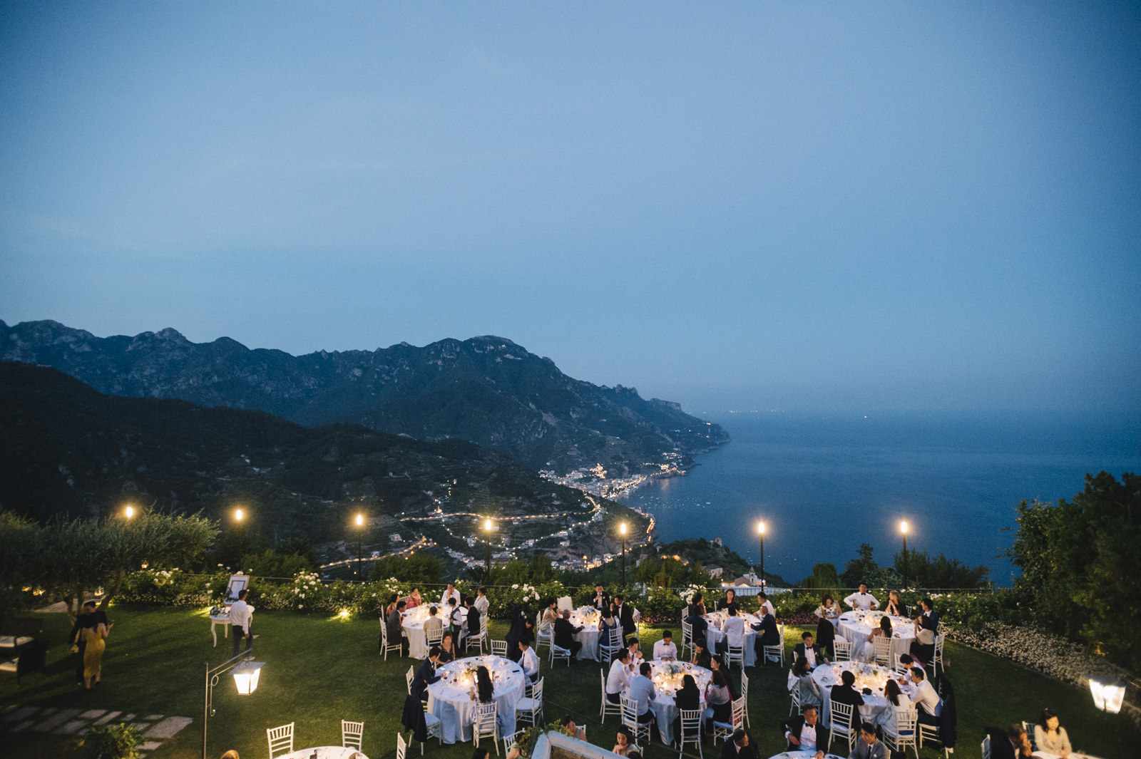 guests during the dinner on a terrace of belmont hotel caruso
