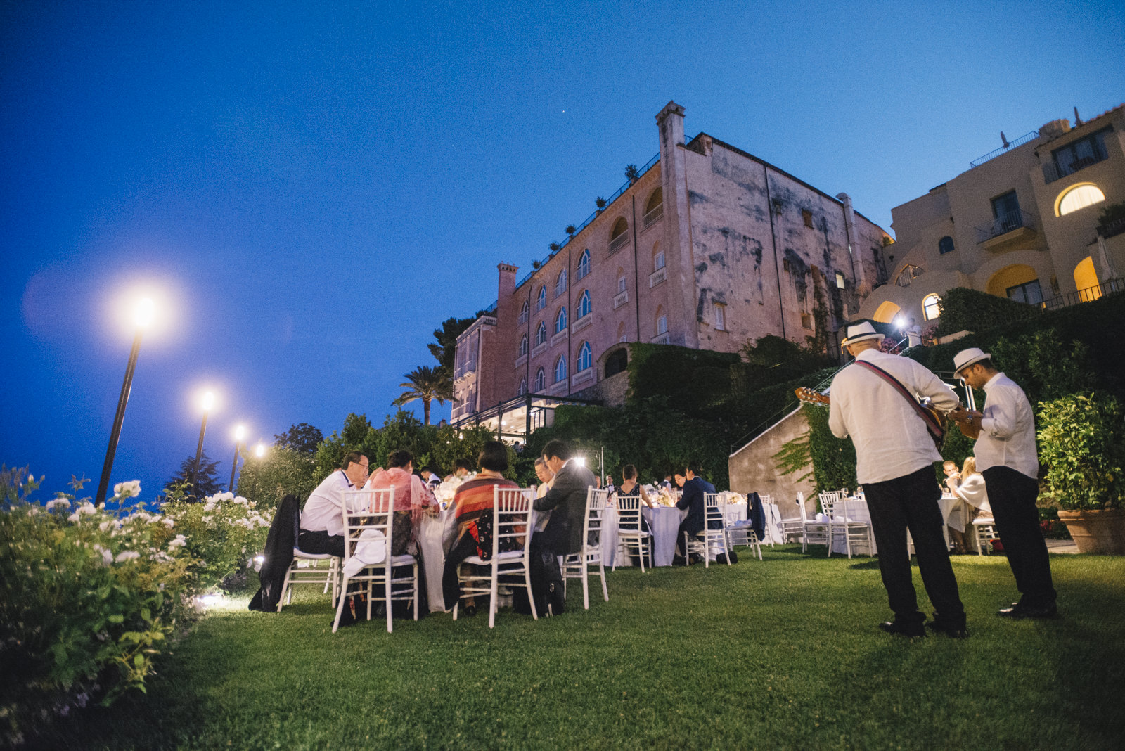 musicians and guests during the dinner party at belmont hotel caruso by night