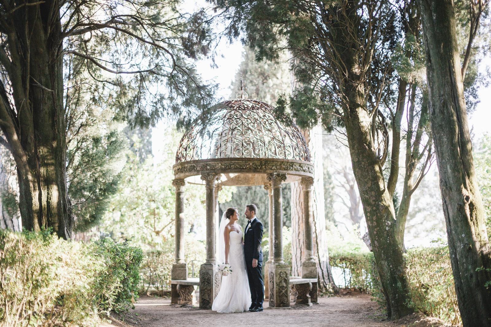 bride and groom's portrait under a small gazebo in villa cimbrone