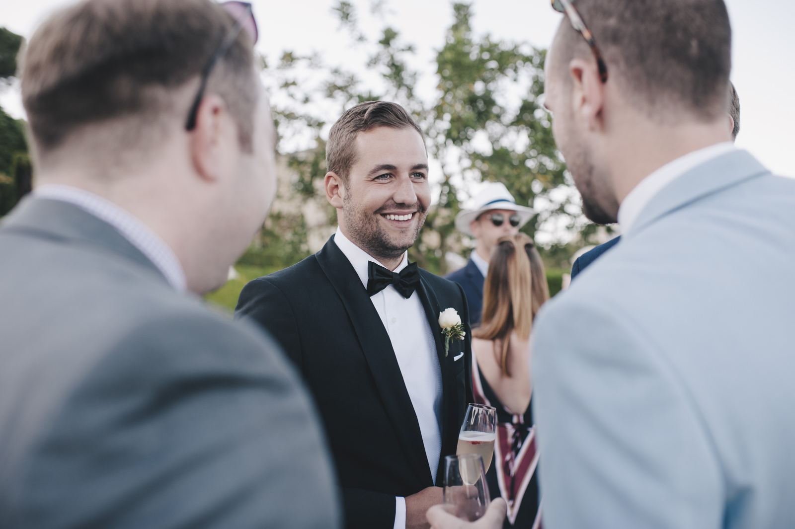 the groom with other guests during the cocktail