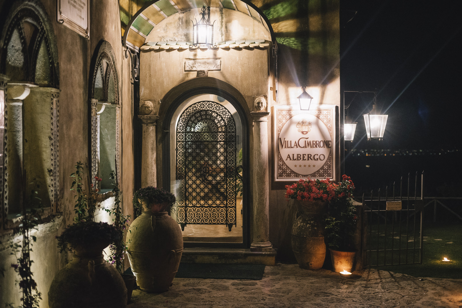 the entrance of villa cimbrone hall by night