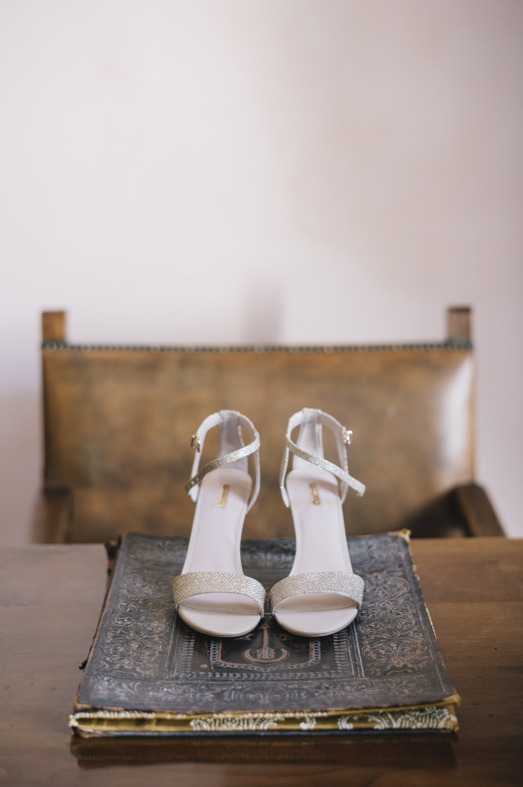 bride's shoes on an ancient book