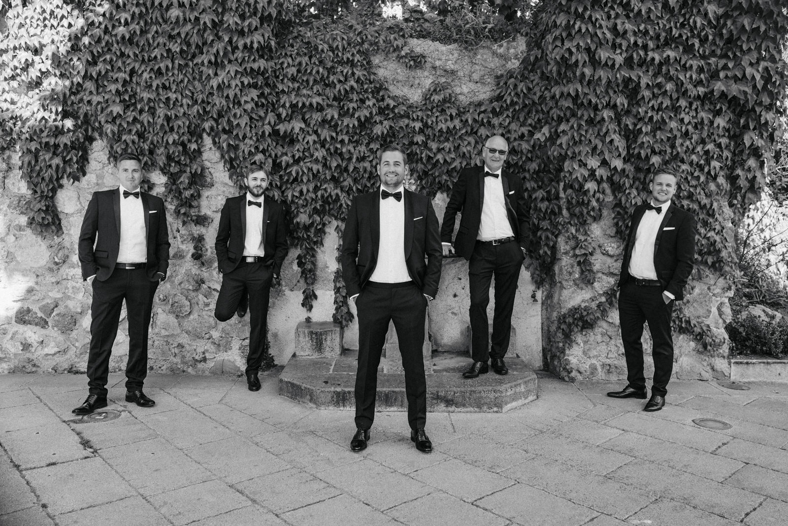 group photo of the groom with the best men in black and white