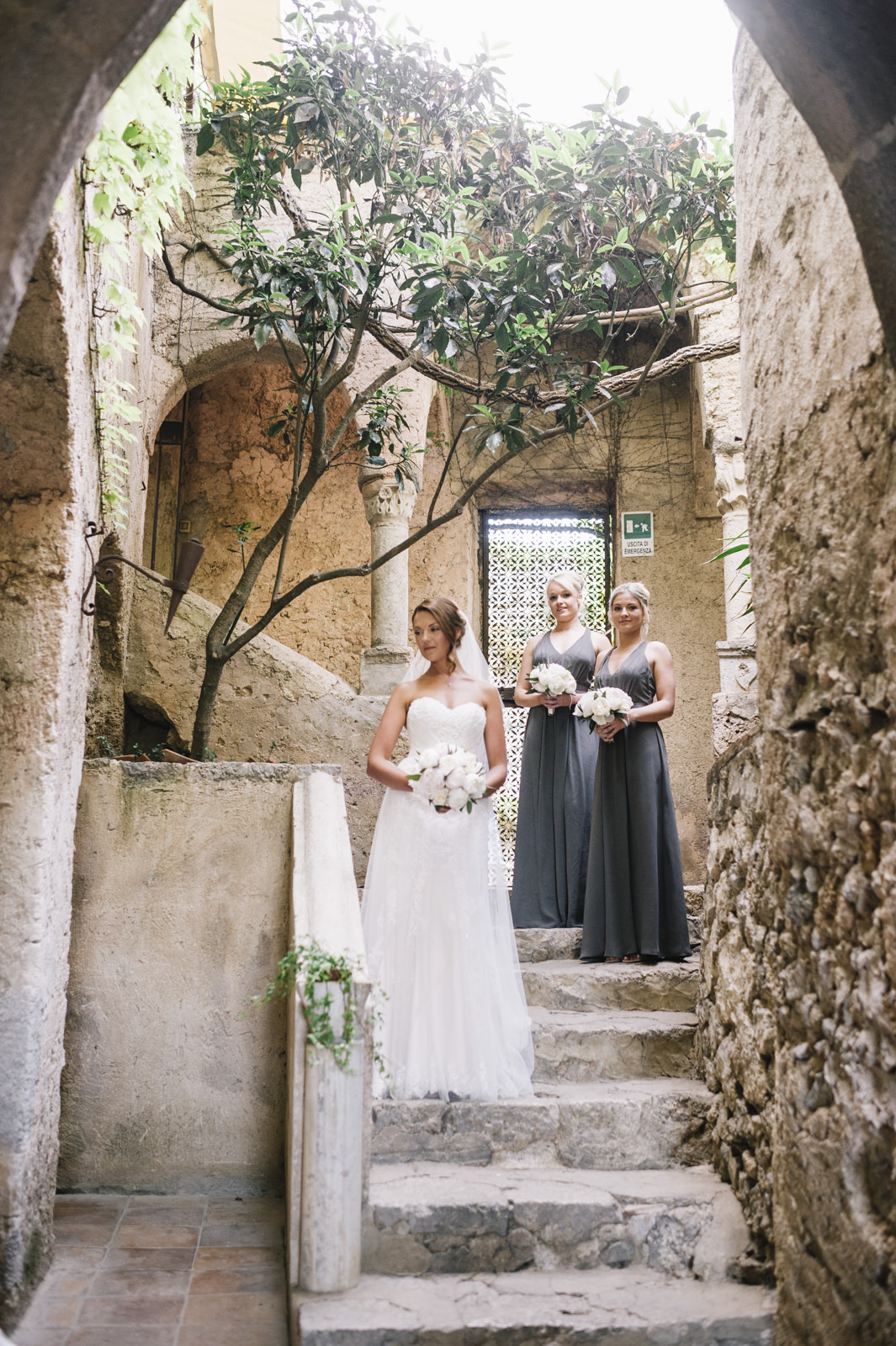 the bride and two bridesmaids in villa cimbrone