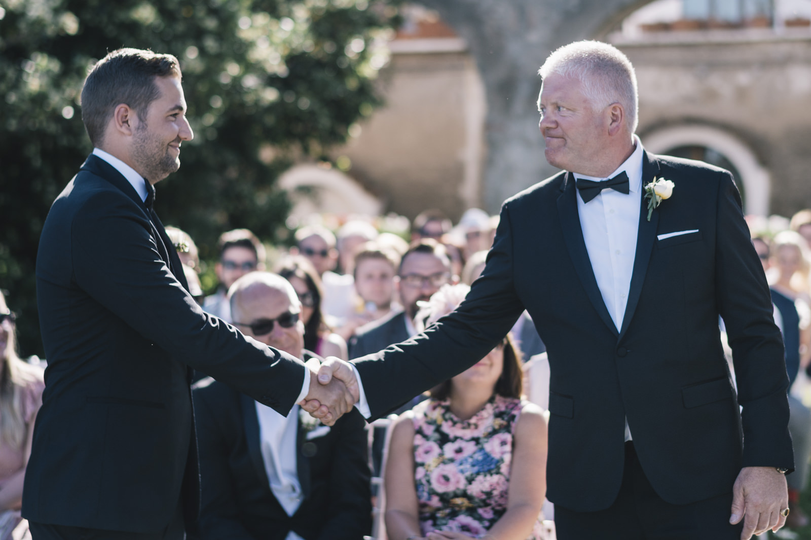 the groom shaking hands with the bride's father