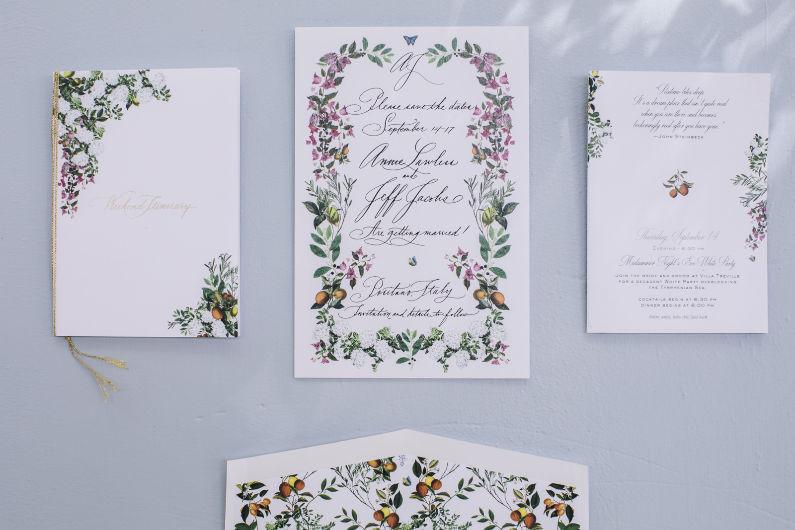 wedding invitation cards on a light blue wall