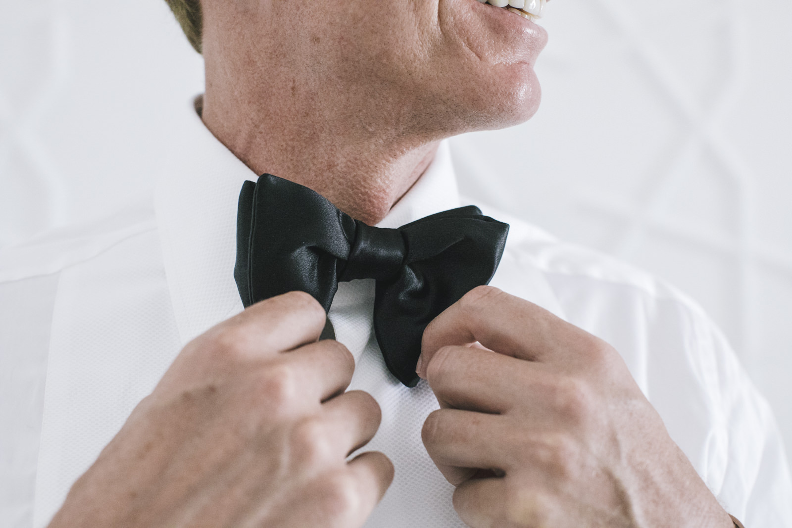 the groom wearing his bowtie
