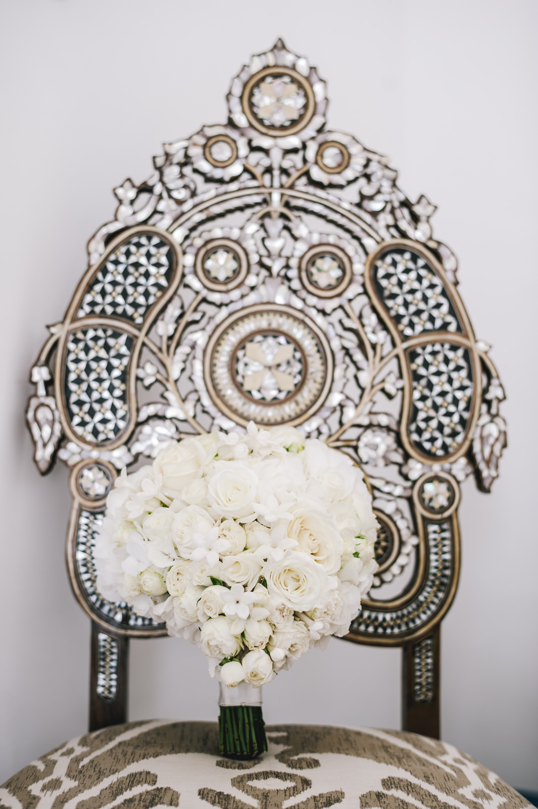 the wedding bouquet on a golden chair