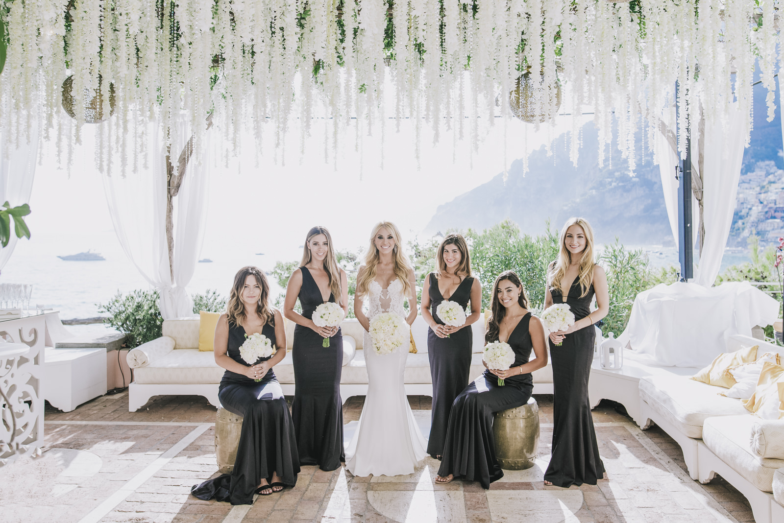 the bride with the bridesmaids in black dress
