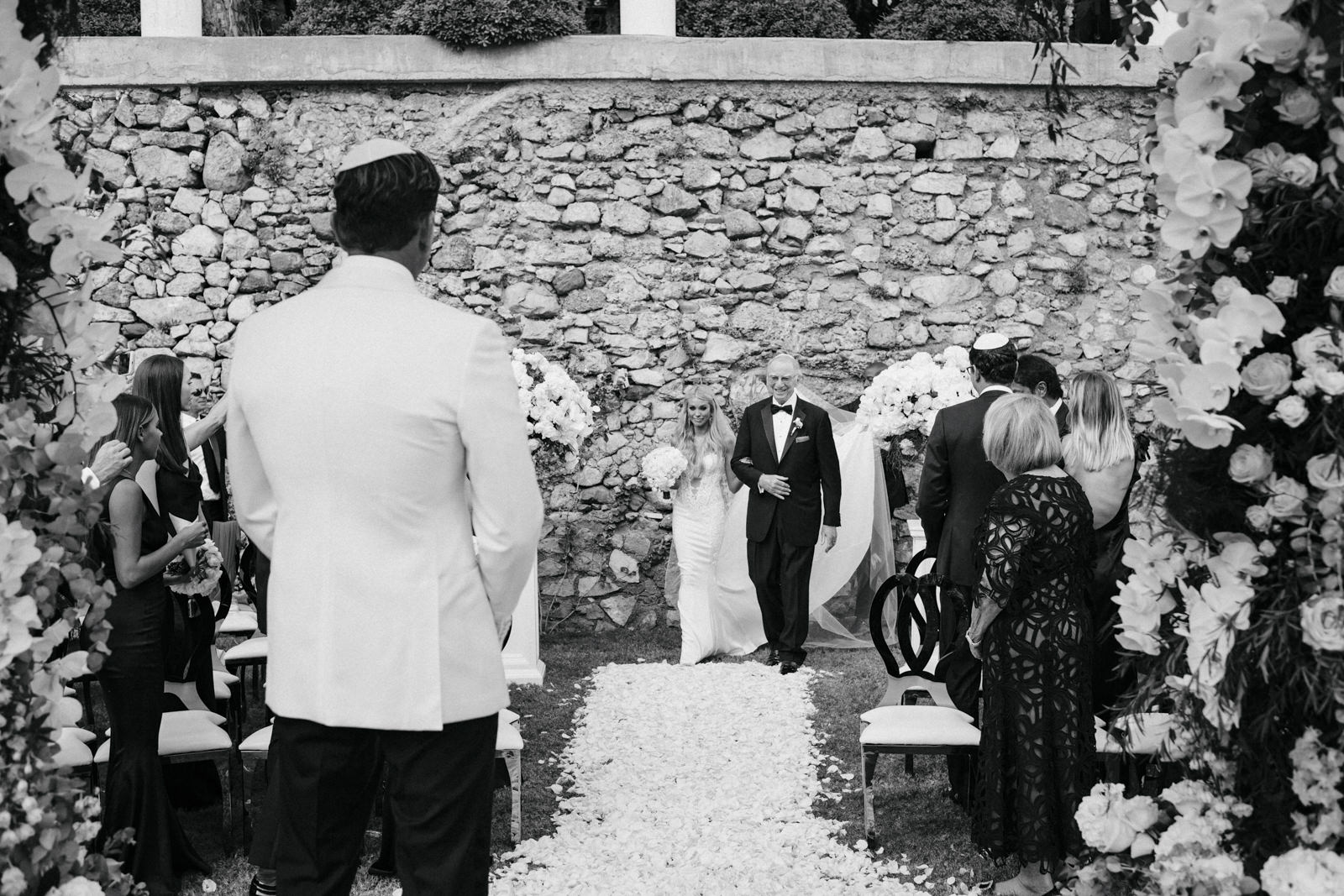 the bride with her father walking down the aisle