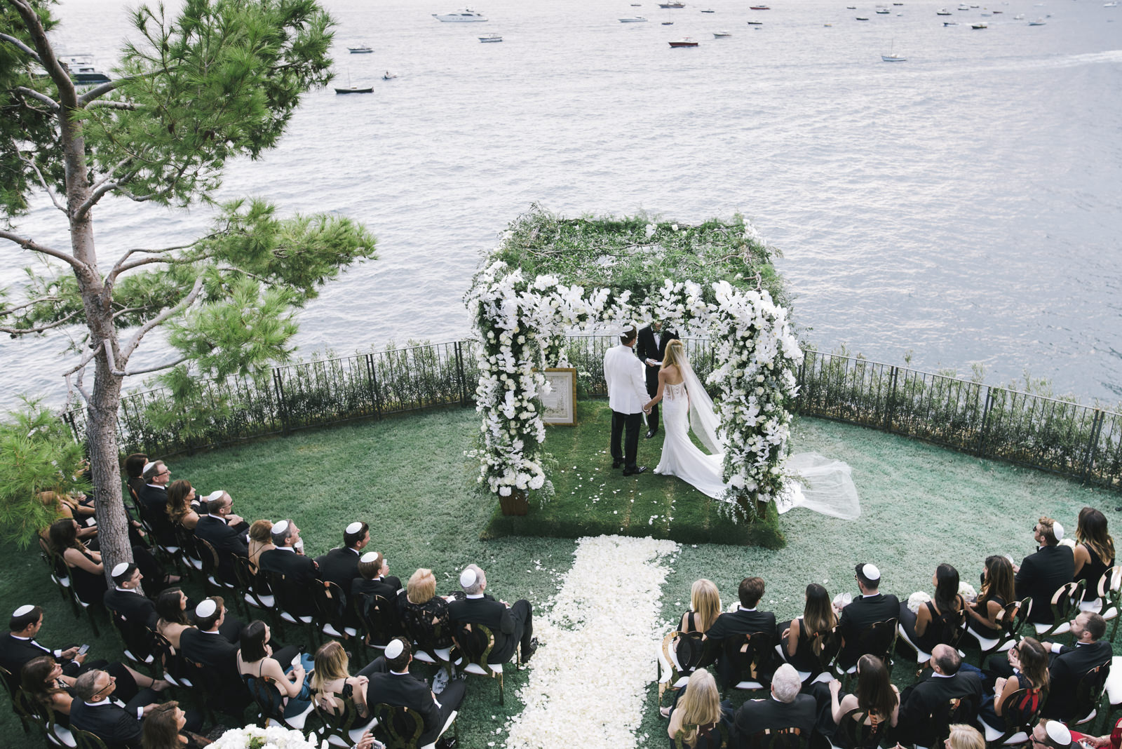 the bride and the groom during the ceremony on a terrace of villa tre ville in positano