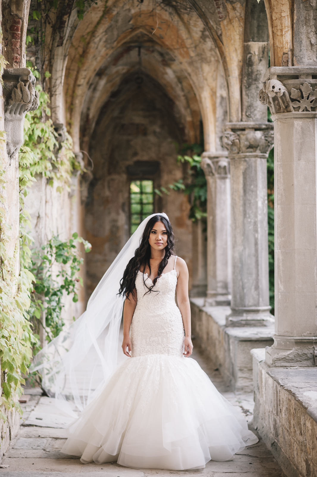 bride's standing by marble columns